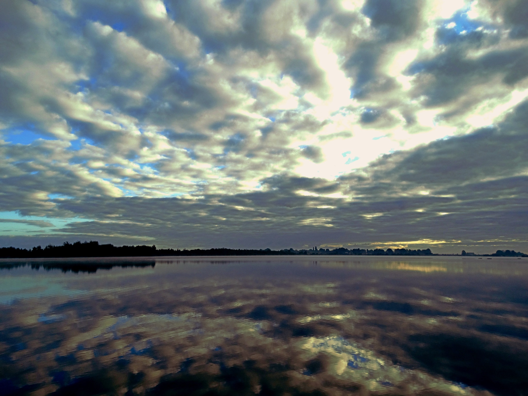 Cloudy sky over the lake! by GertdeVos