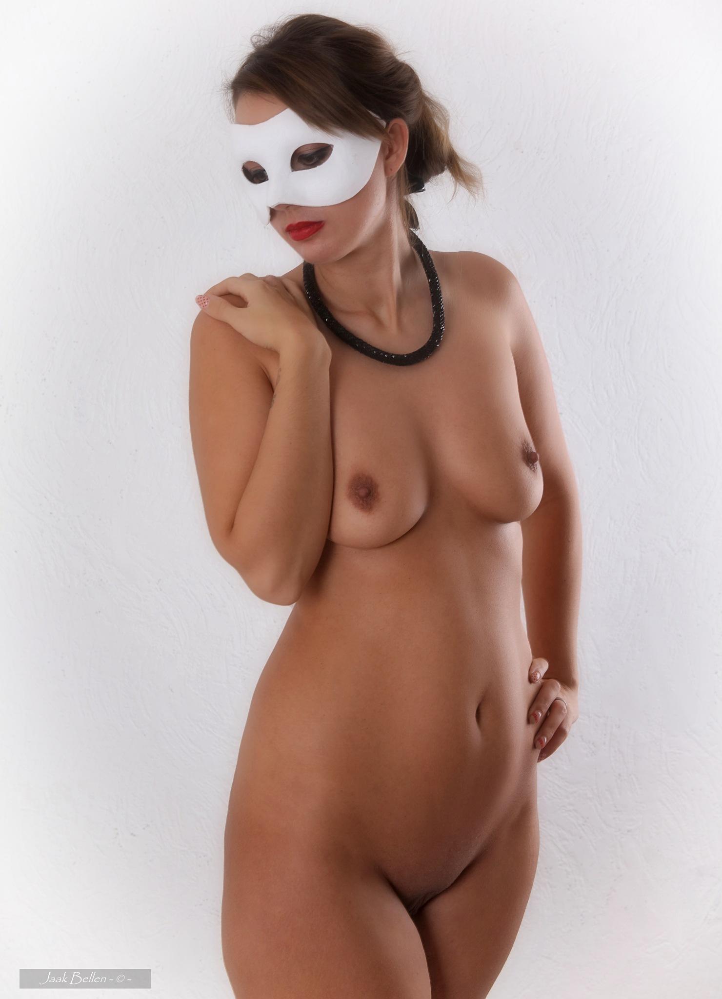 Rebecca wearing a mask..... by Jaak BELLEN