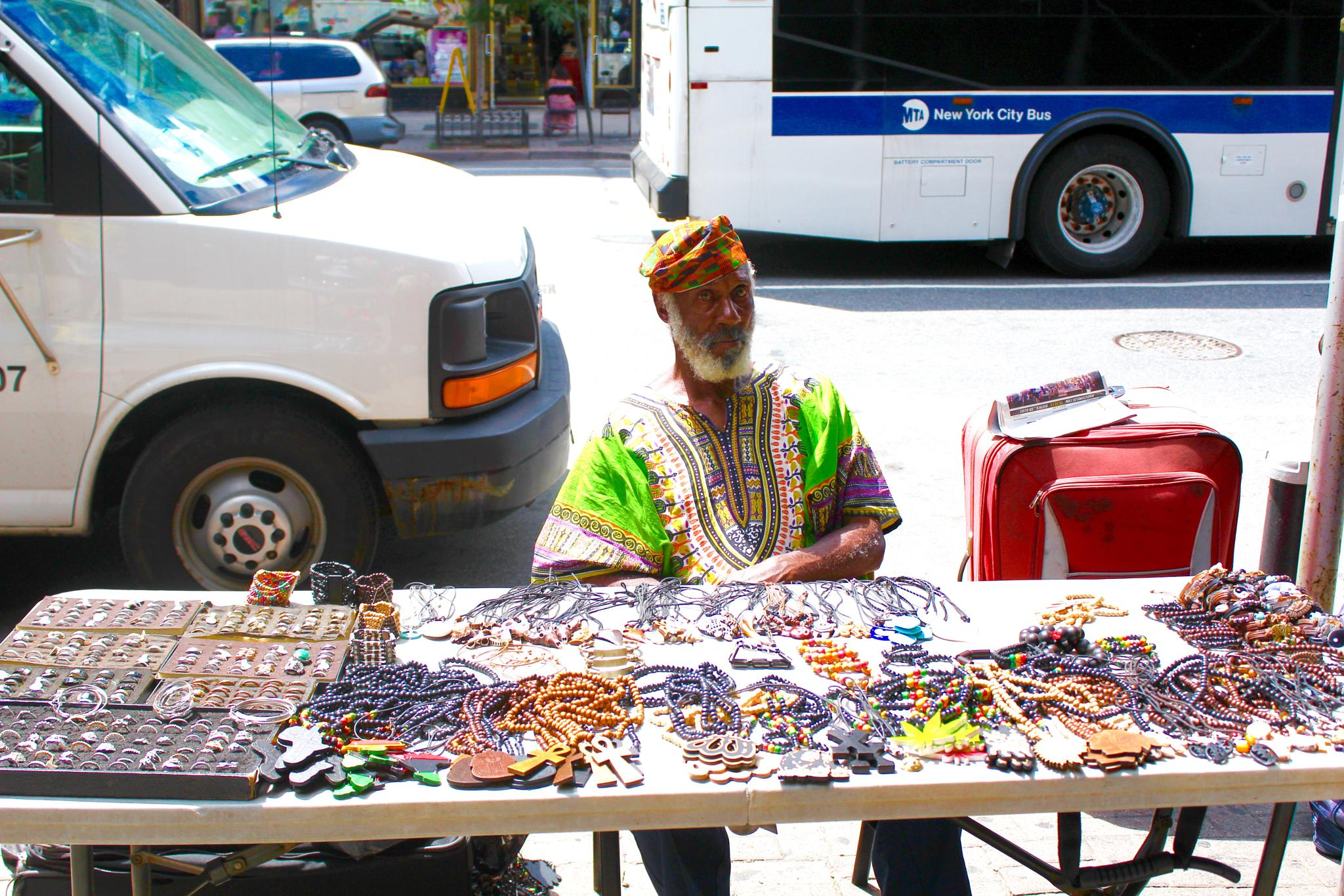 Vendor in Harlem by Snickandmephotography