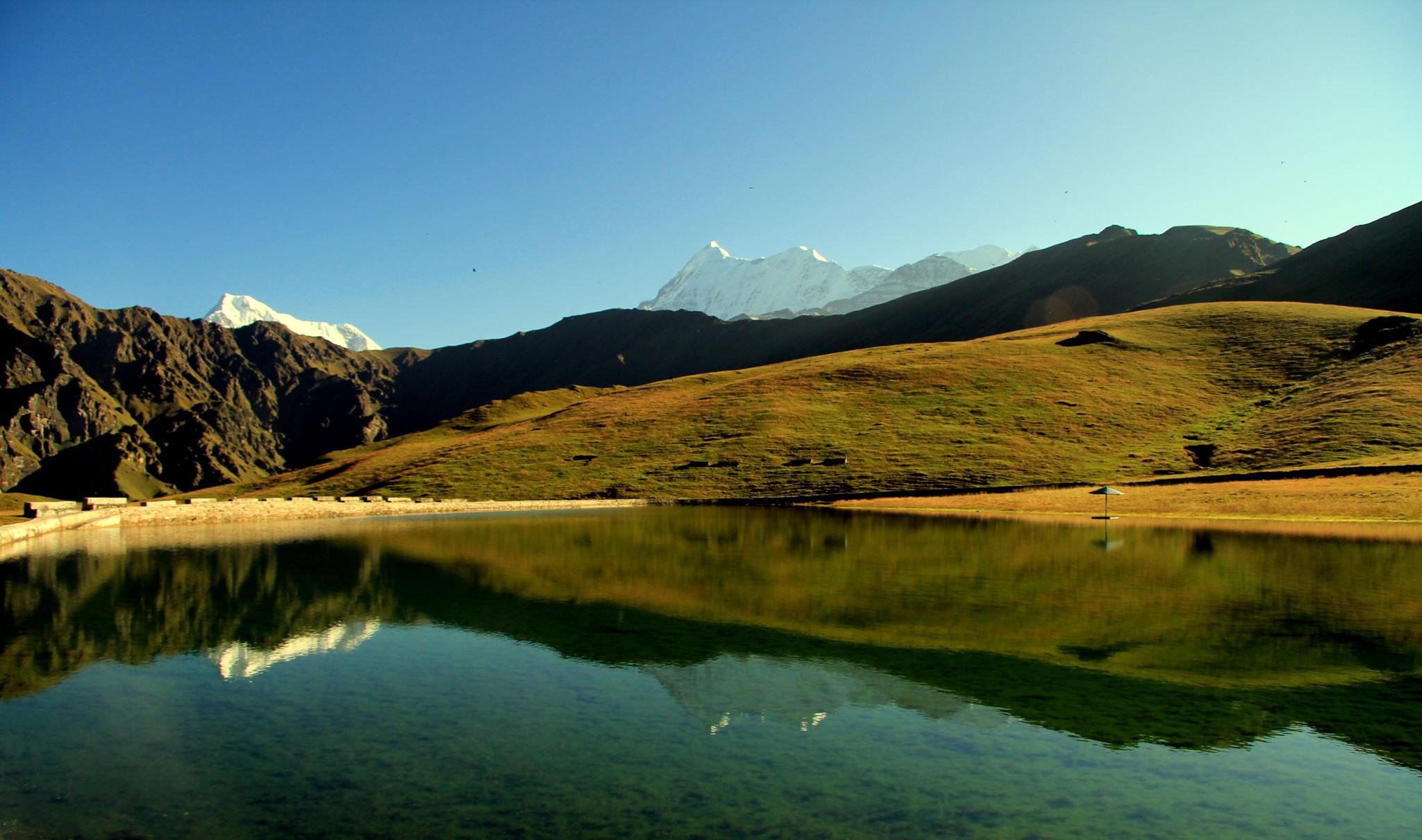 Reflection of Mt.Trishul and Nanda Ghunti on Bedni Kund by madhujith