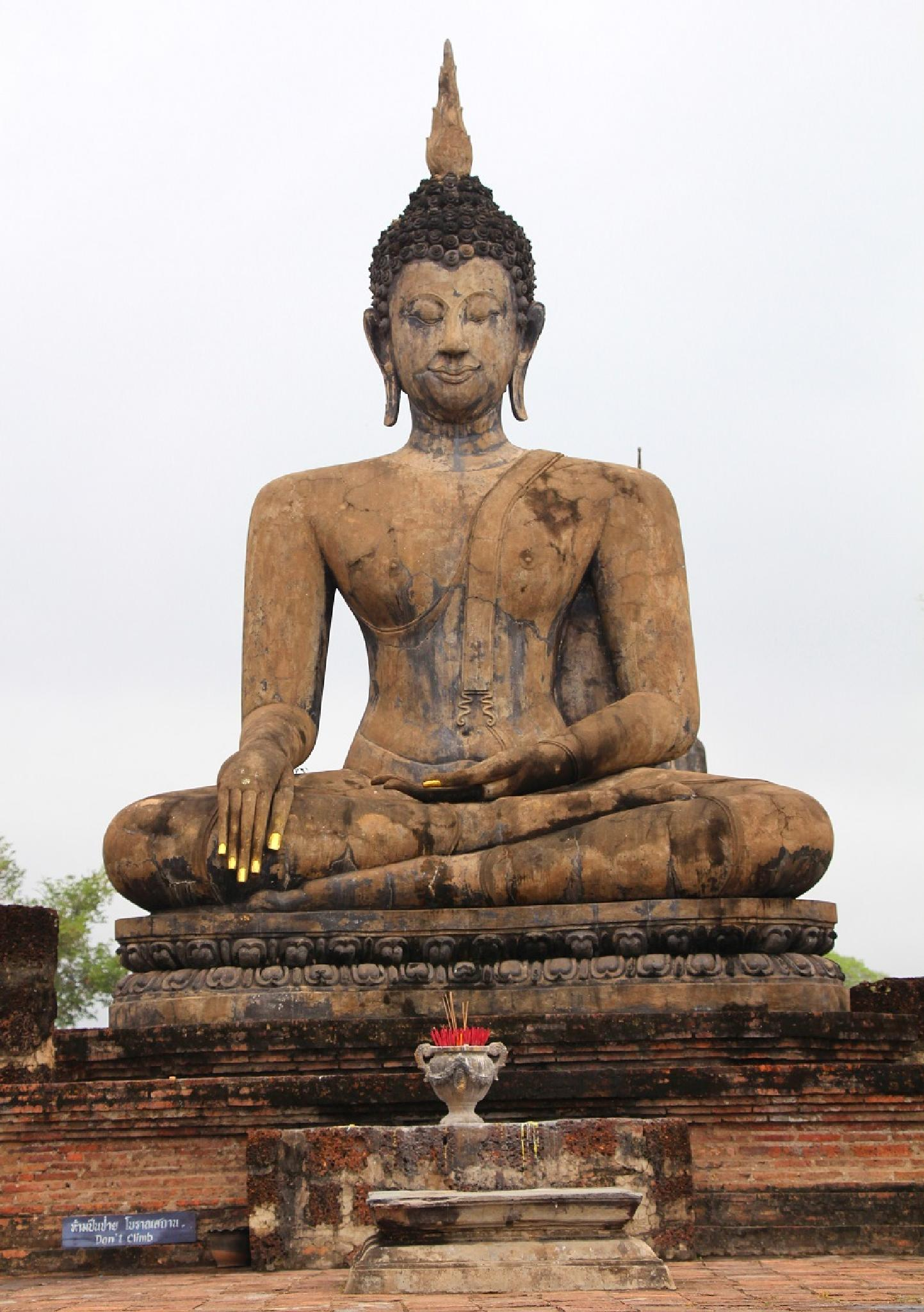 Buddha Statue in Sukhothai Historical Park   by Michael Mettier