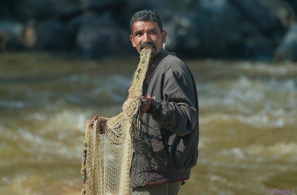 trout fish catcher by Tima Timappa