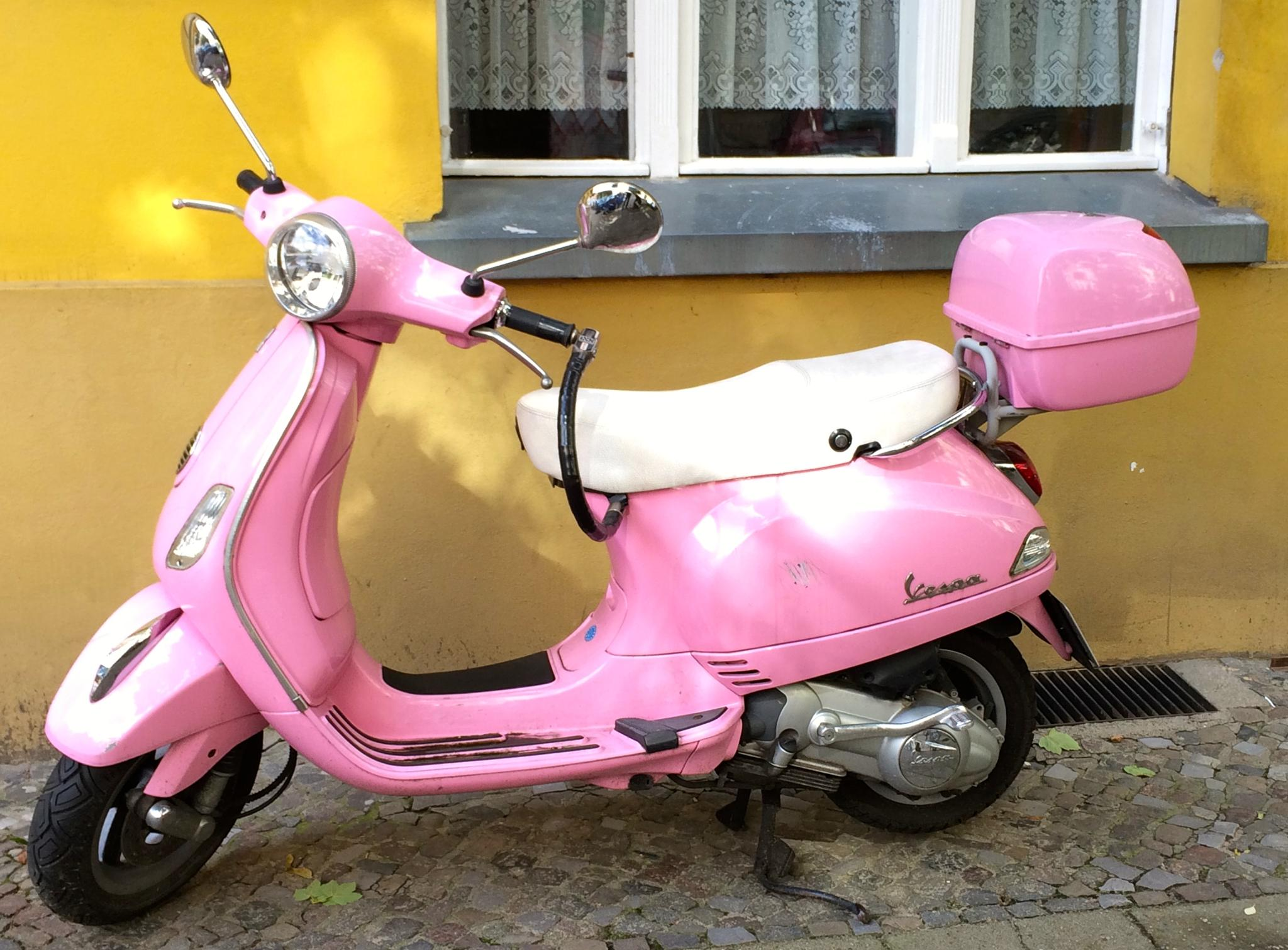 pink vespa in front of yellow house by m.etemadieh