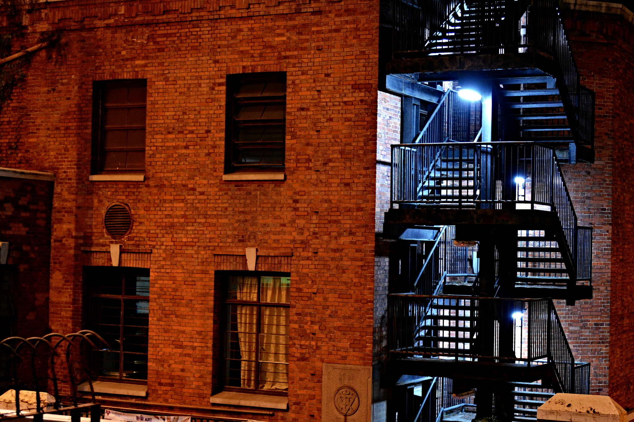Photo in Architecture #street #night #metalic #stairs #lights #mysterious #building