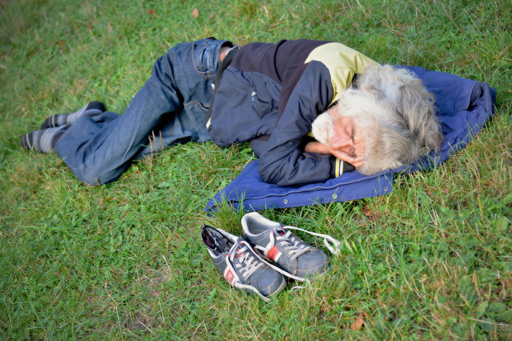 An afternoon siesta in park. by marcel cintalan