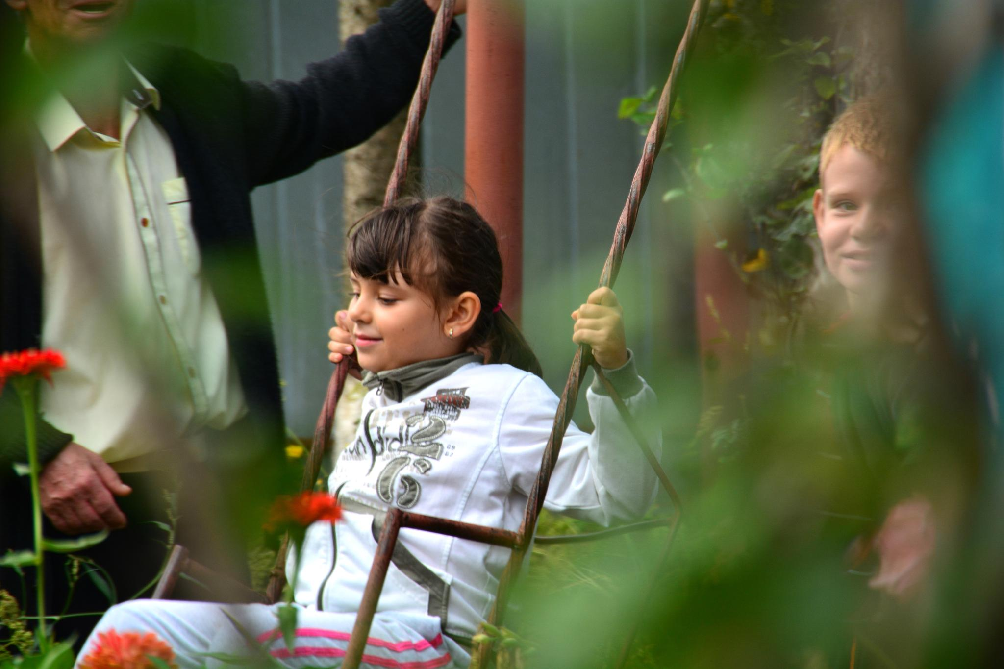 Childrens playing by Silviu Calistru