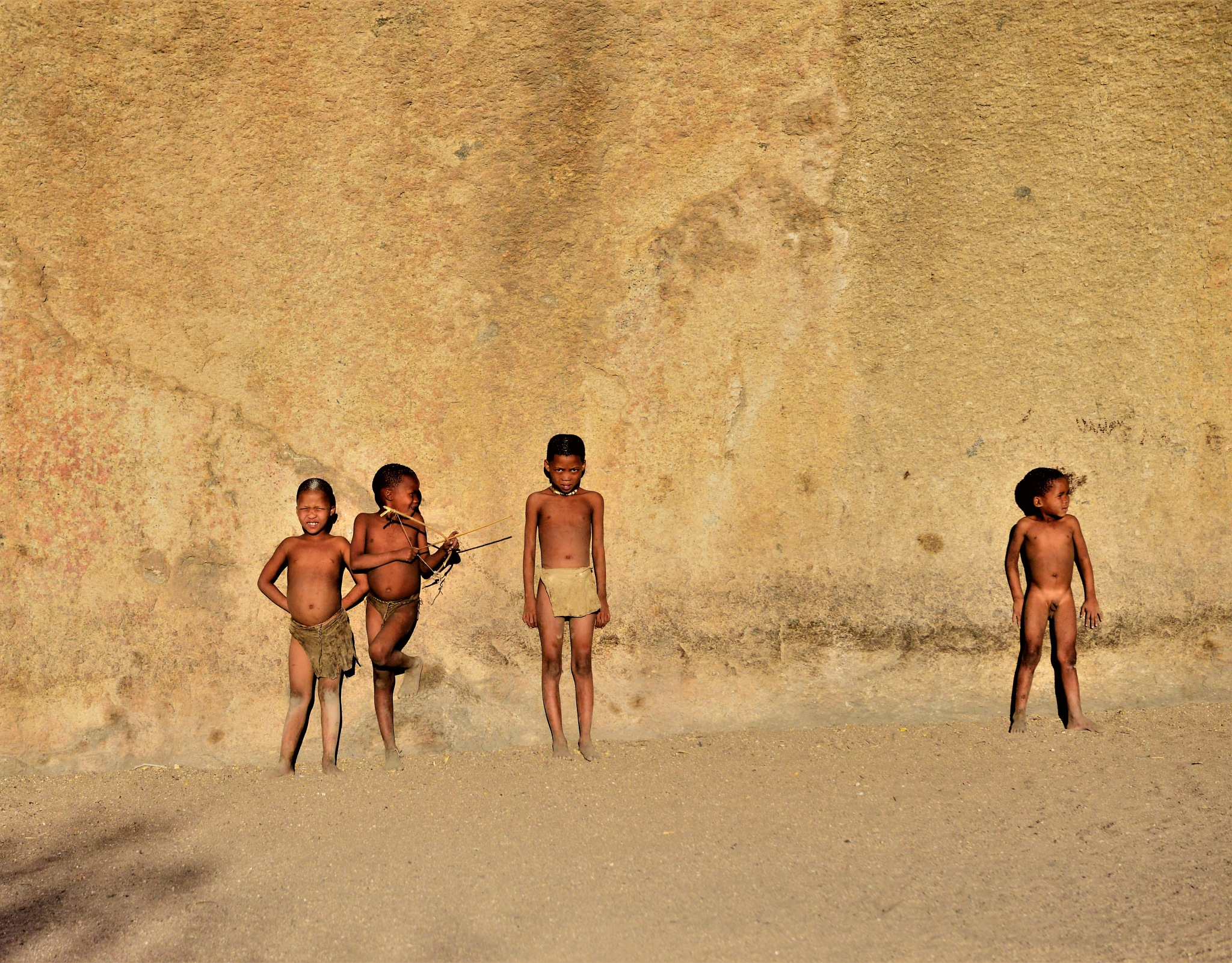 4 Ju/'Hoansi-San boys at play by Connie M Van Cleve