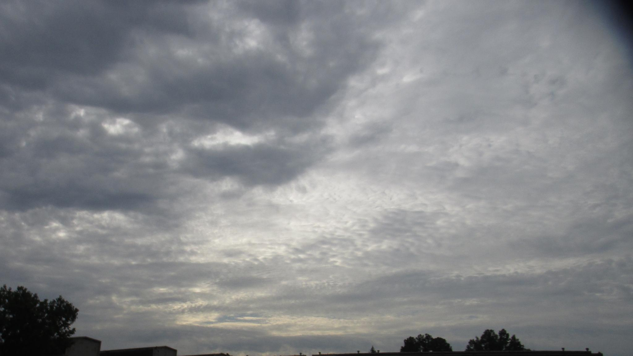Clouds over work by Elora Young Longstreth