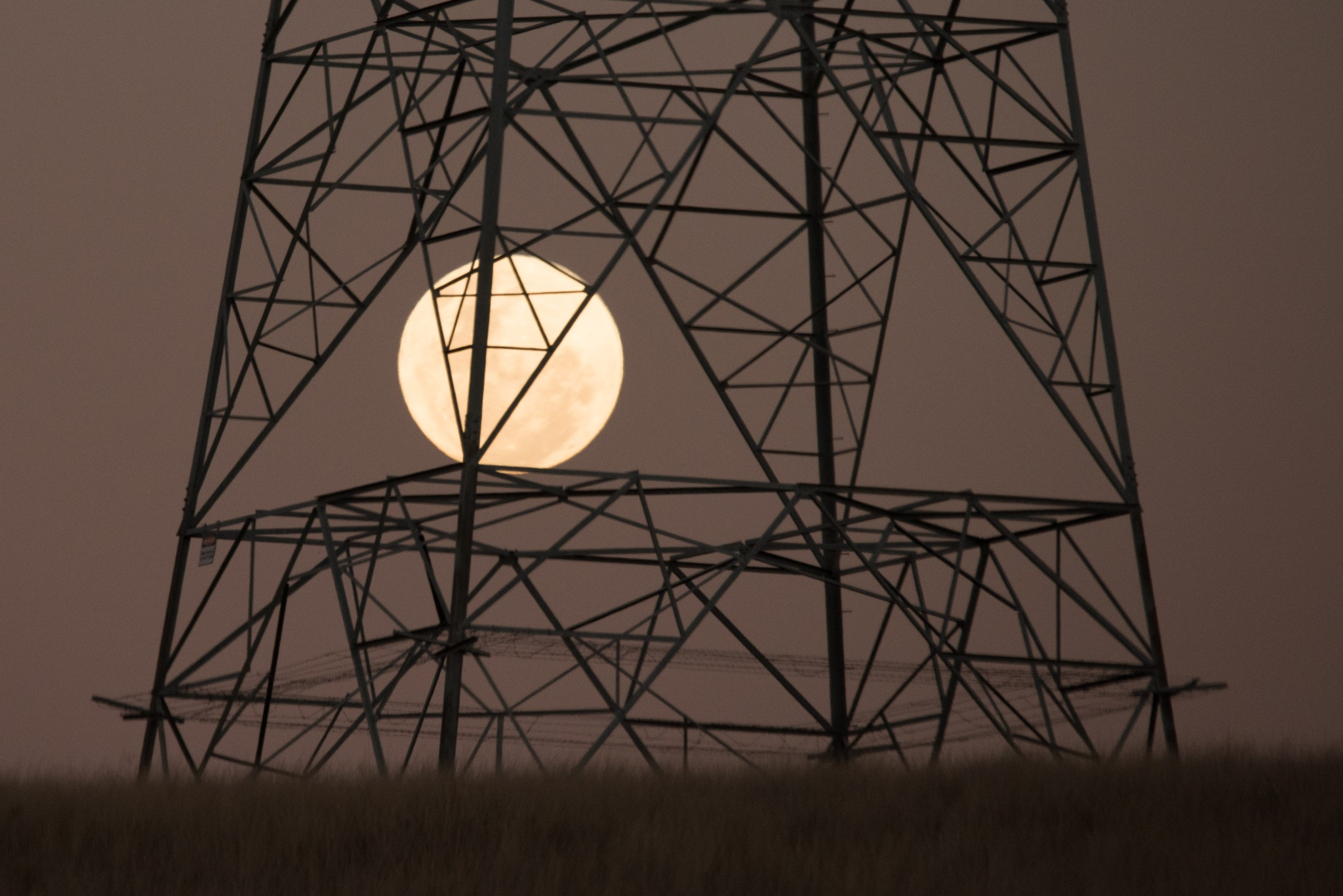 moon thru the pylon  by Karl Neuman