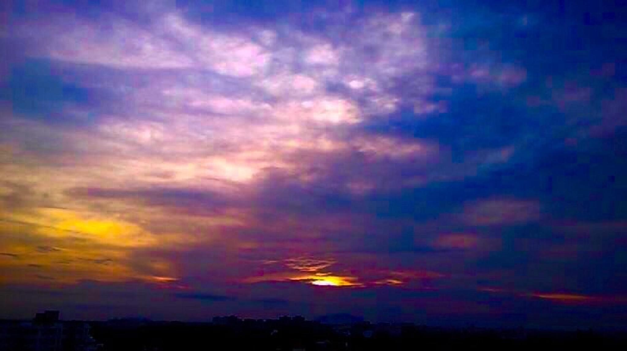 Sunrise over the city by Anjana Chakraborti