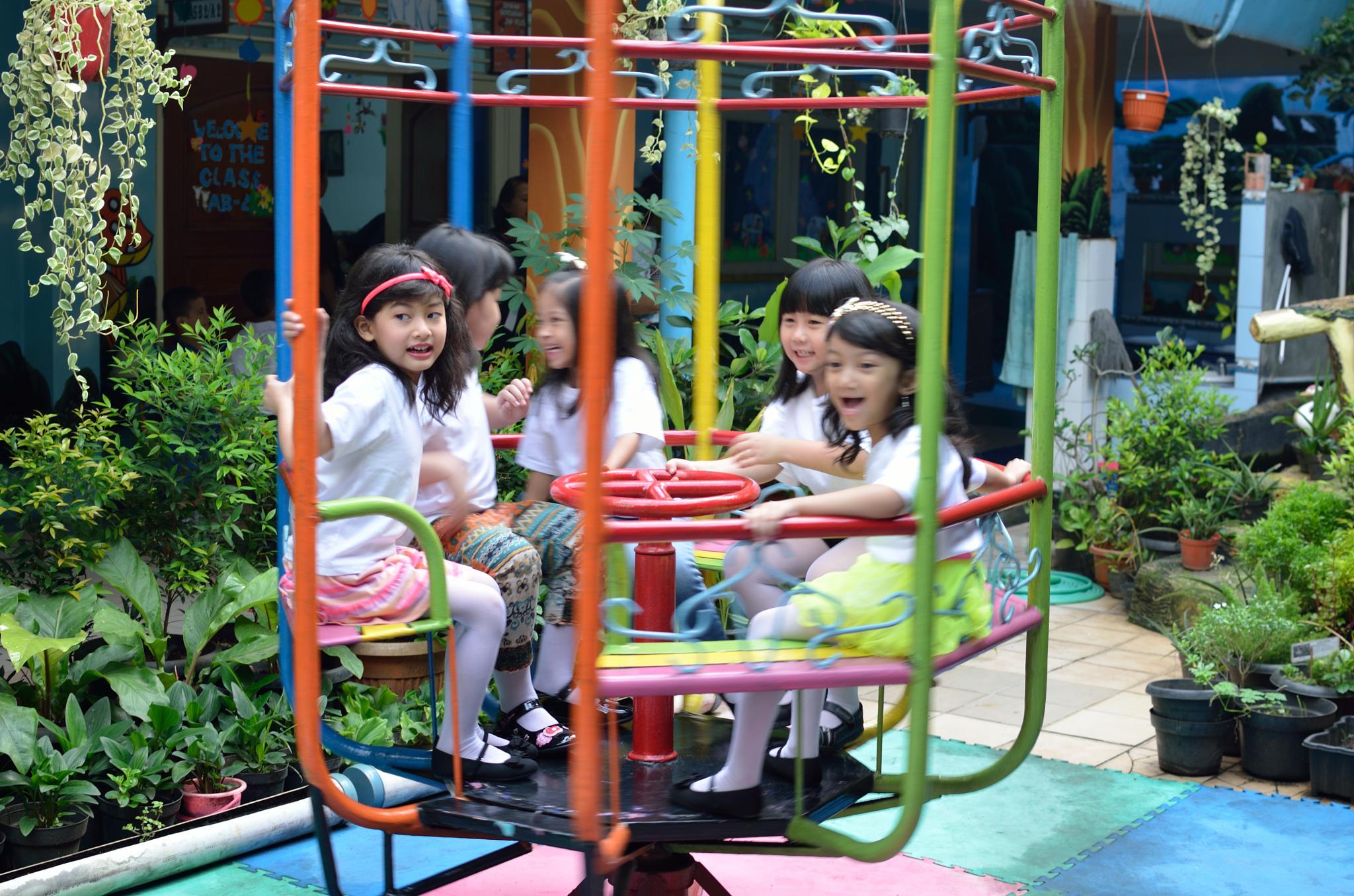 Children Playing by Yulius
