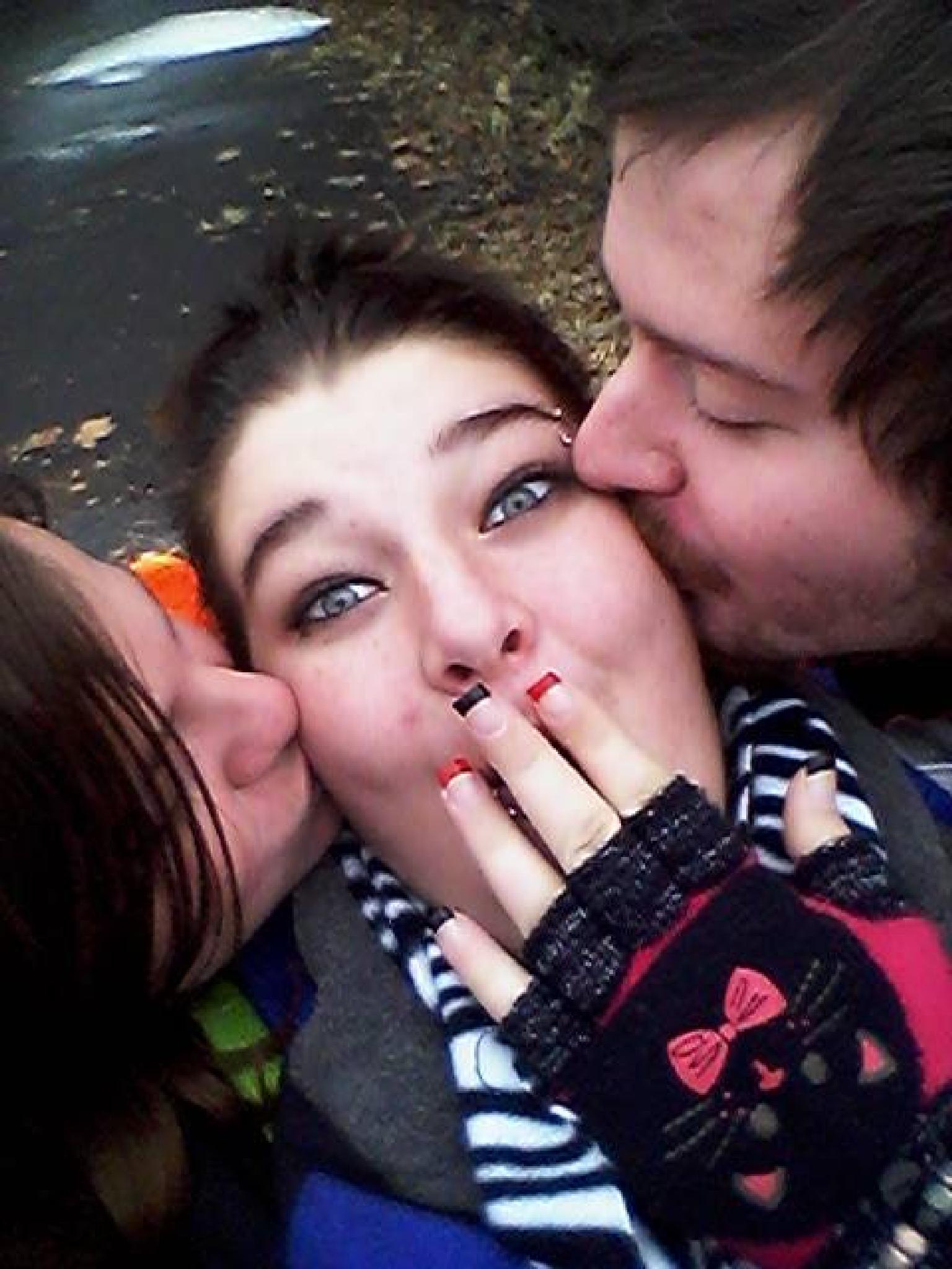 My Daughter in the middle~ her bf ~ and her friend by Dee