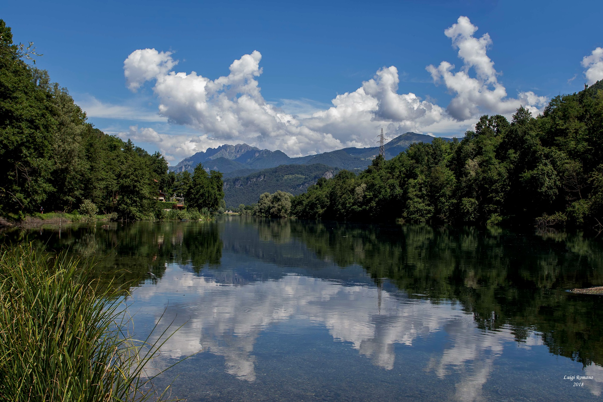 Mount Resegone that is reflected in the Adda River by Luigi Romano