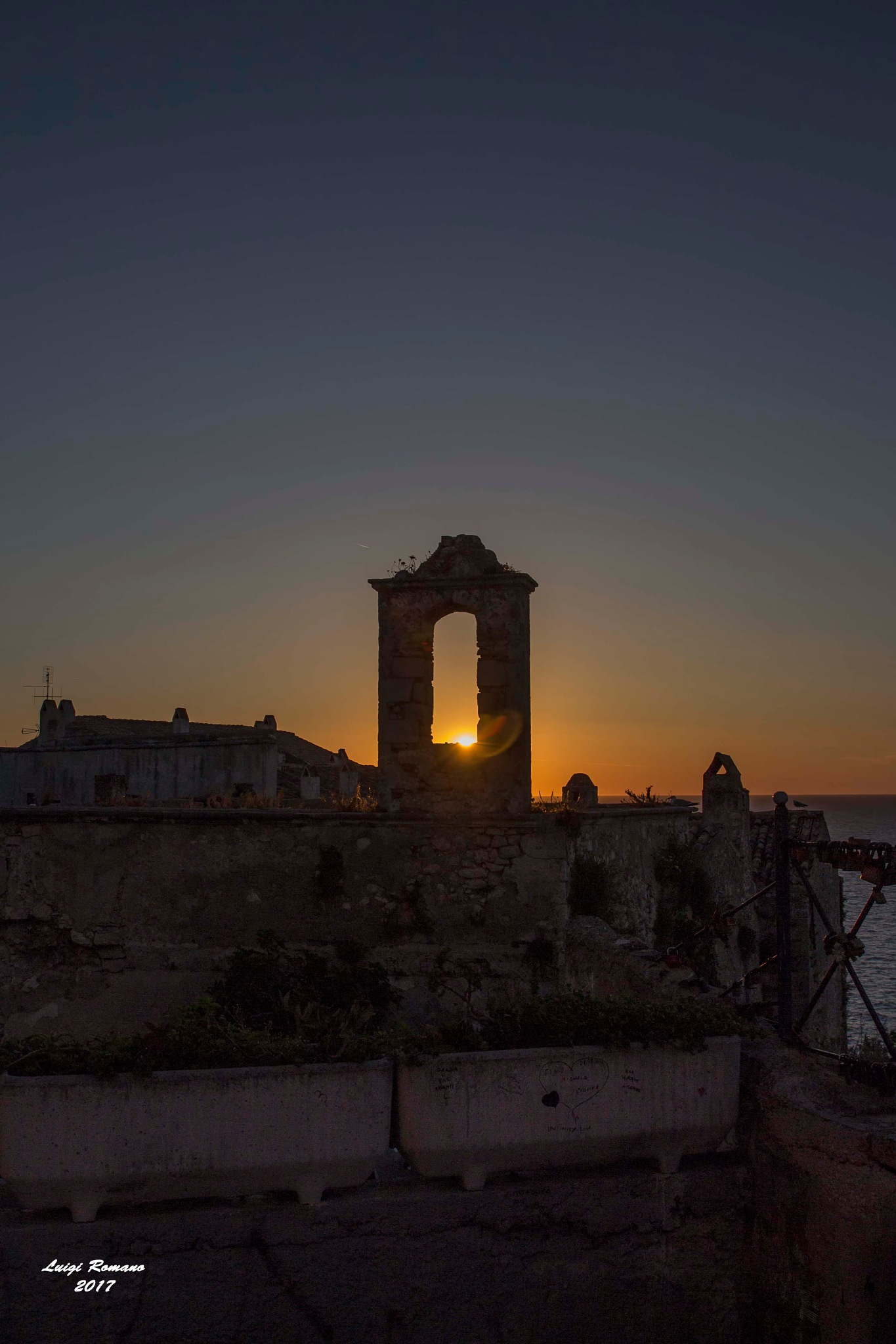Peschici at sunset by Luigi Romano