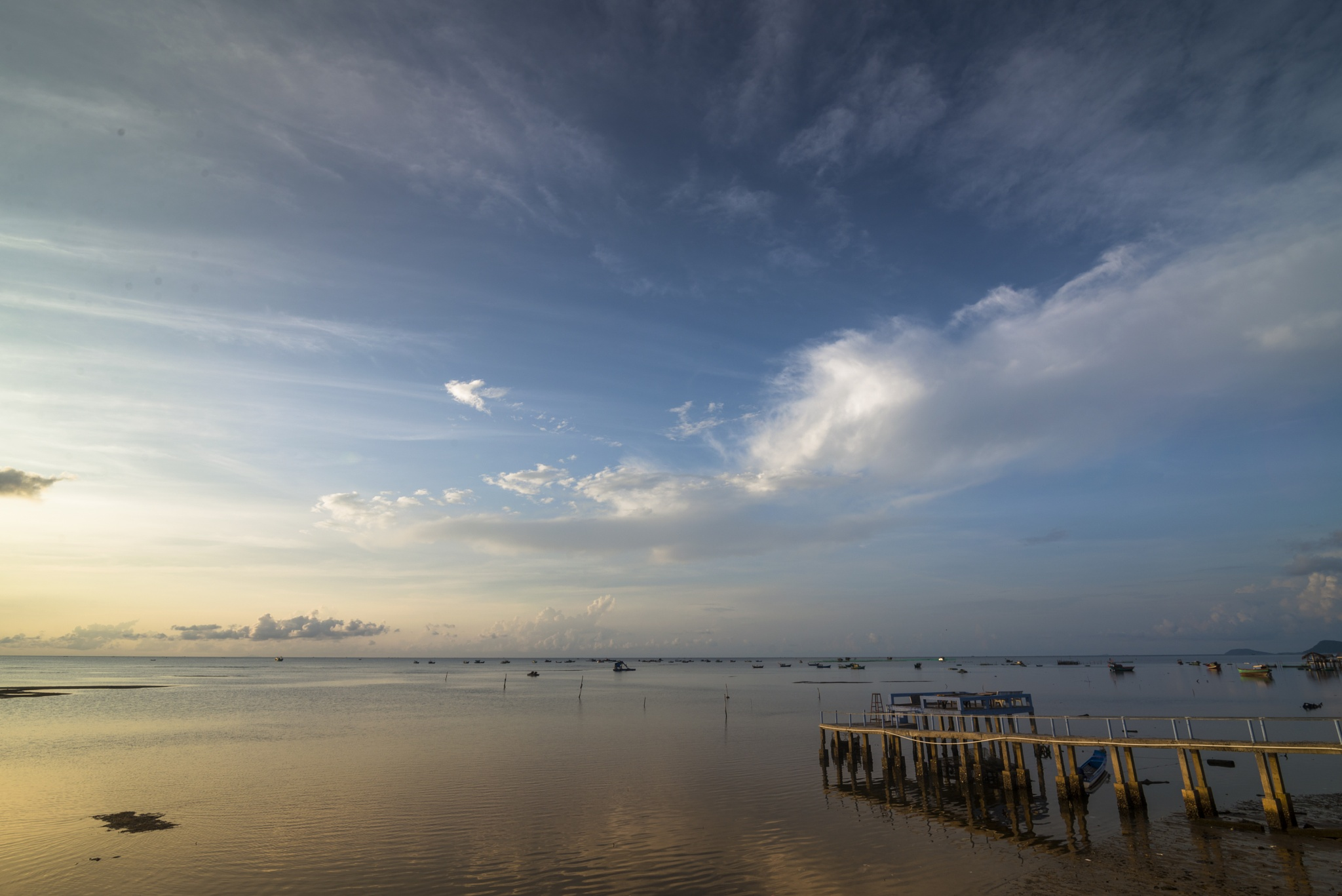 Peaceful sunrise at Ham Ninh fishing village by Quang Le
