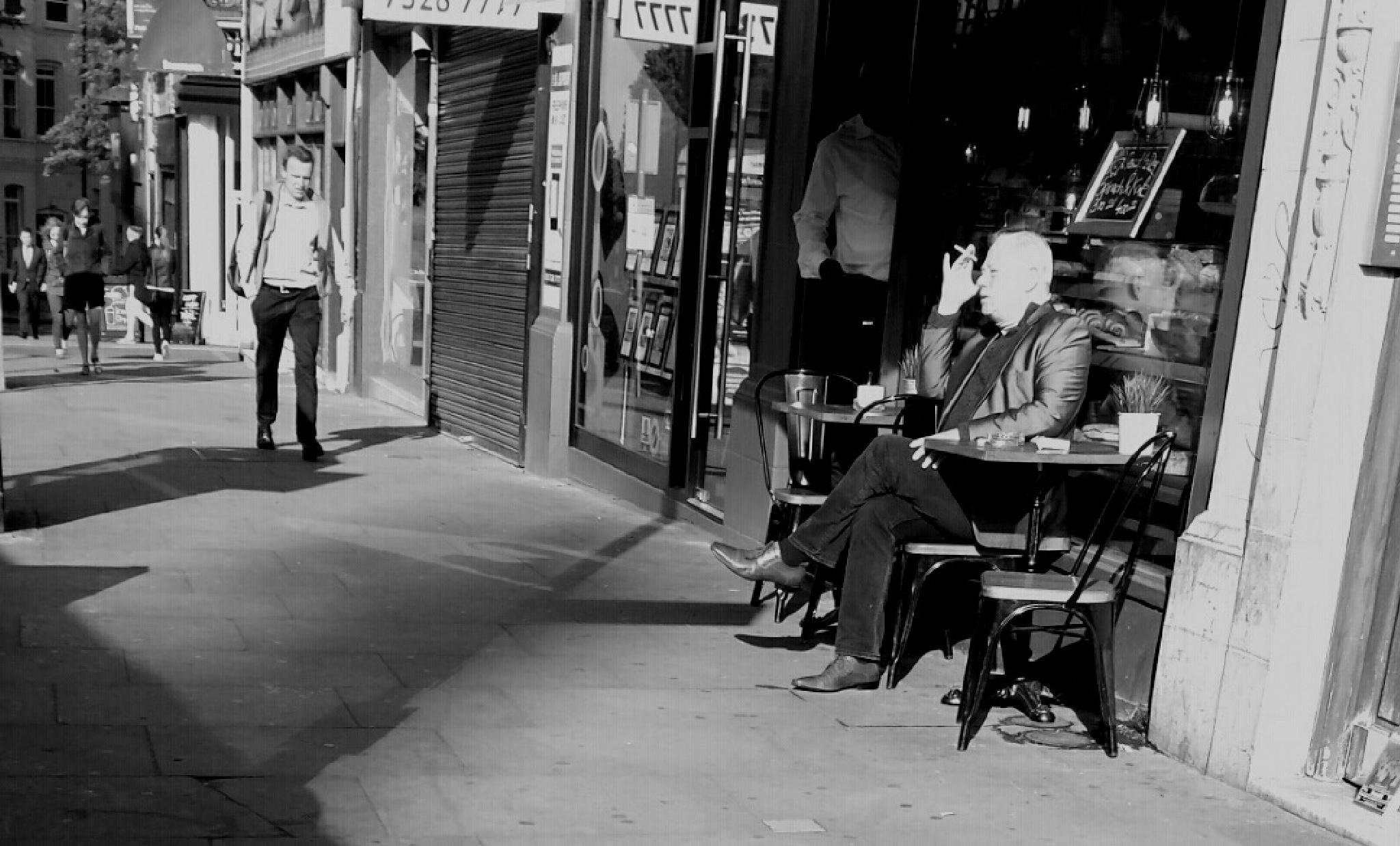 Cafe contemplation by Barry Ellison
