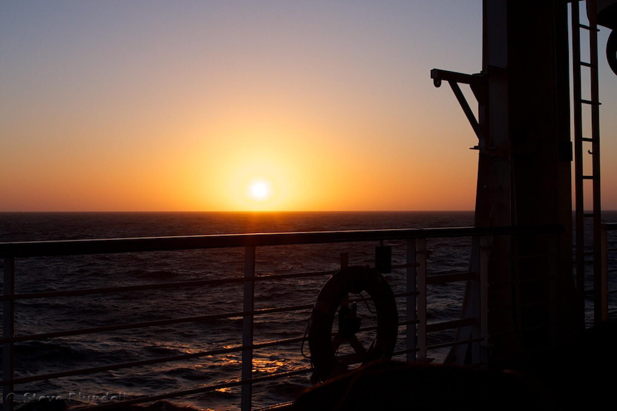 Onboard at sunset by Steve Blundell
