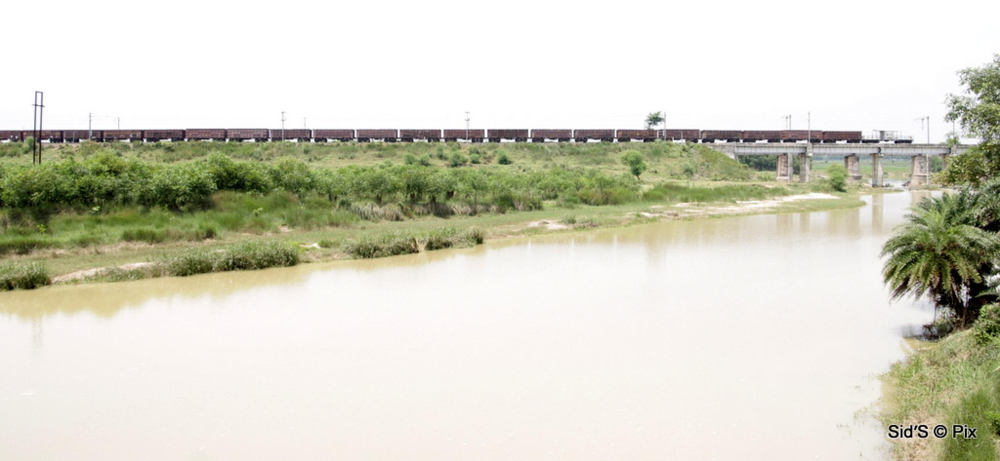 A goods train crossing the river by Siddharth Sanyal