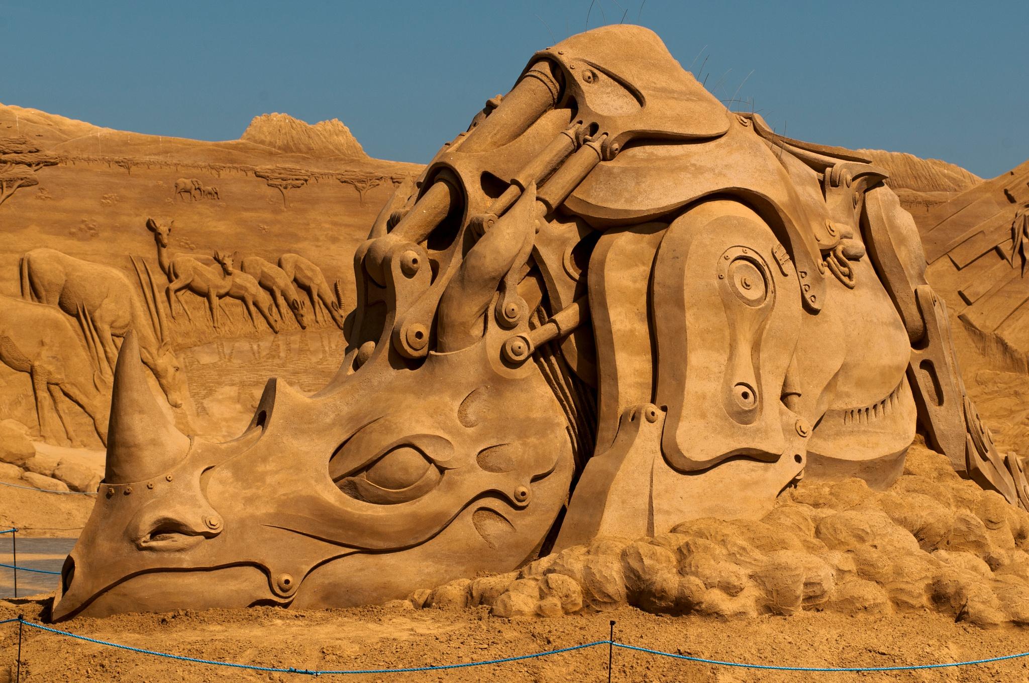 Photo in Sea and Sand #mech rhino #sandsculpture #festival 2016