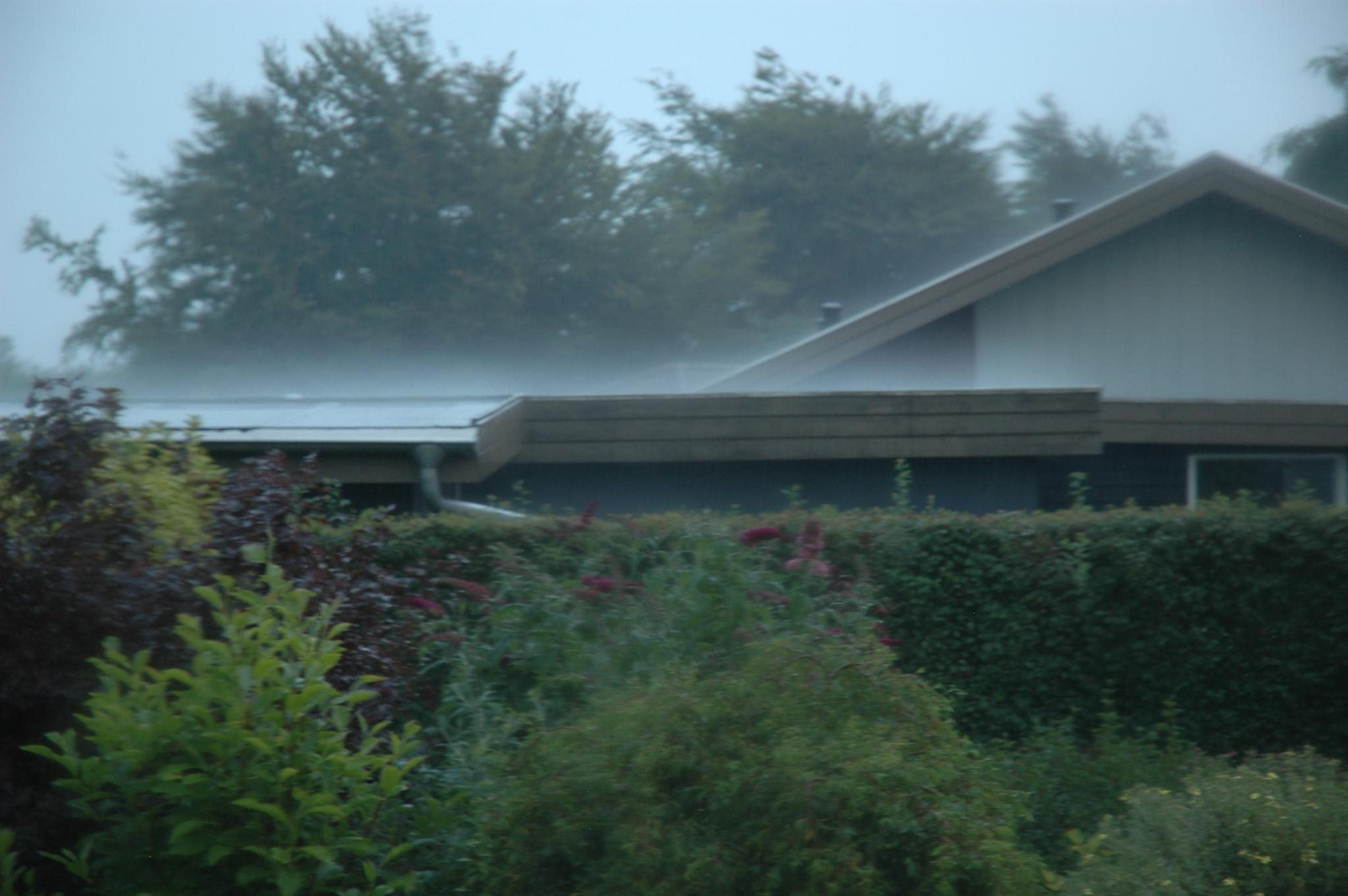 Water vapour on garage roof by Steen Skov