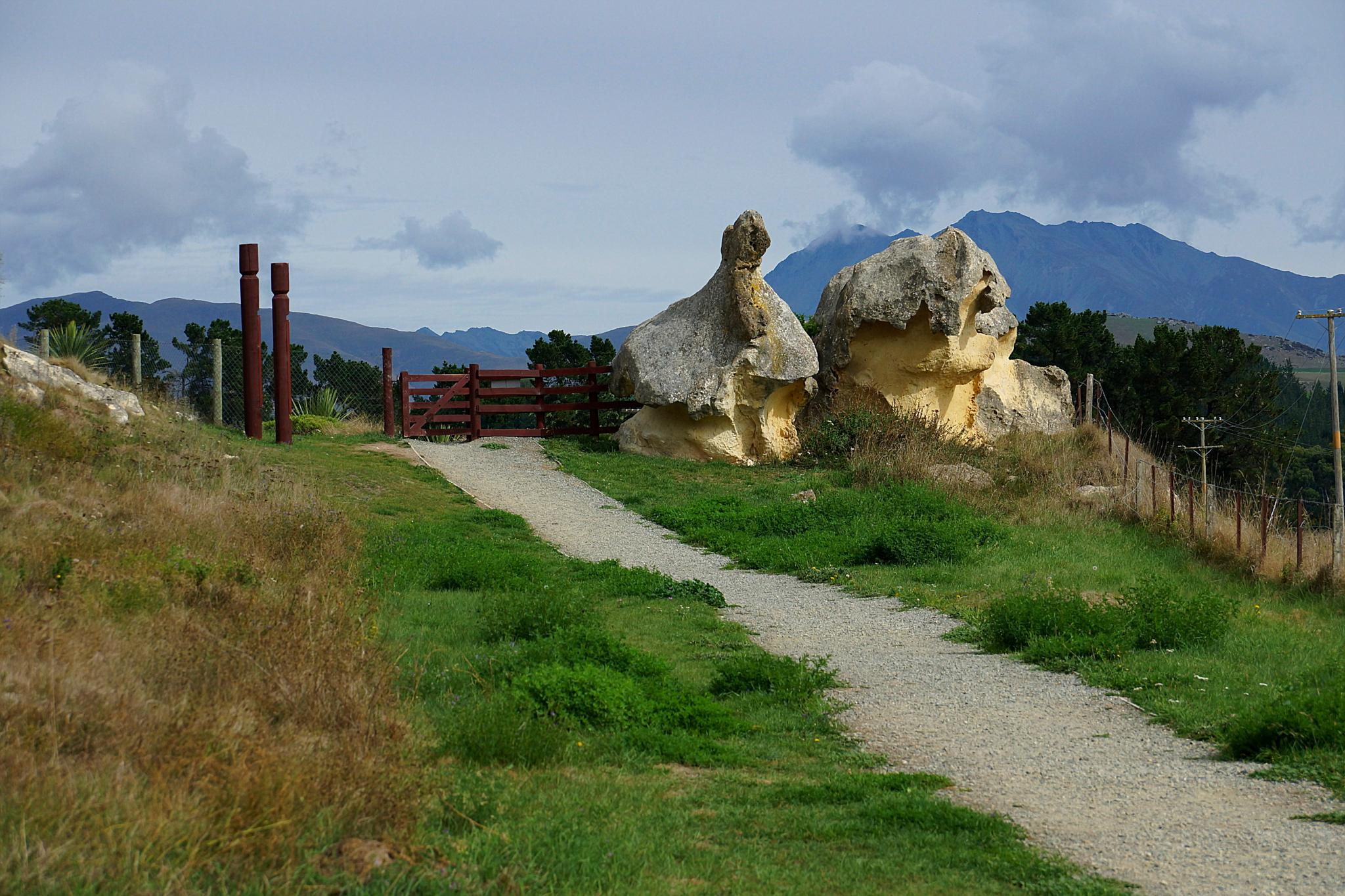 Photo in Landscape #mountains #rocks #gate #footpath #posts