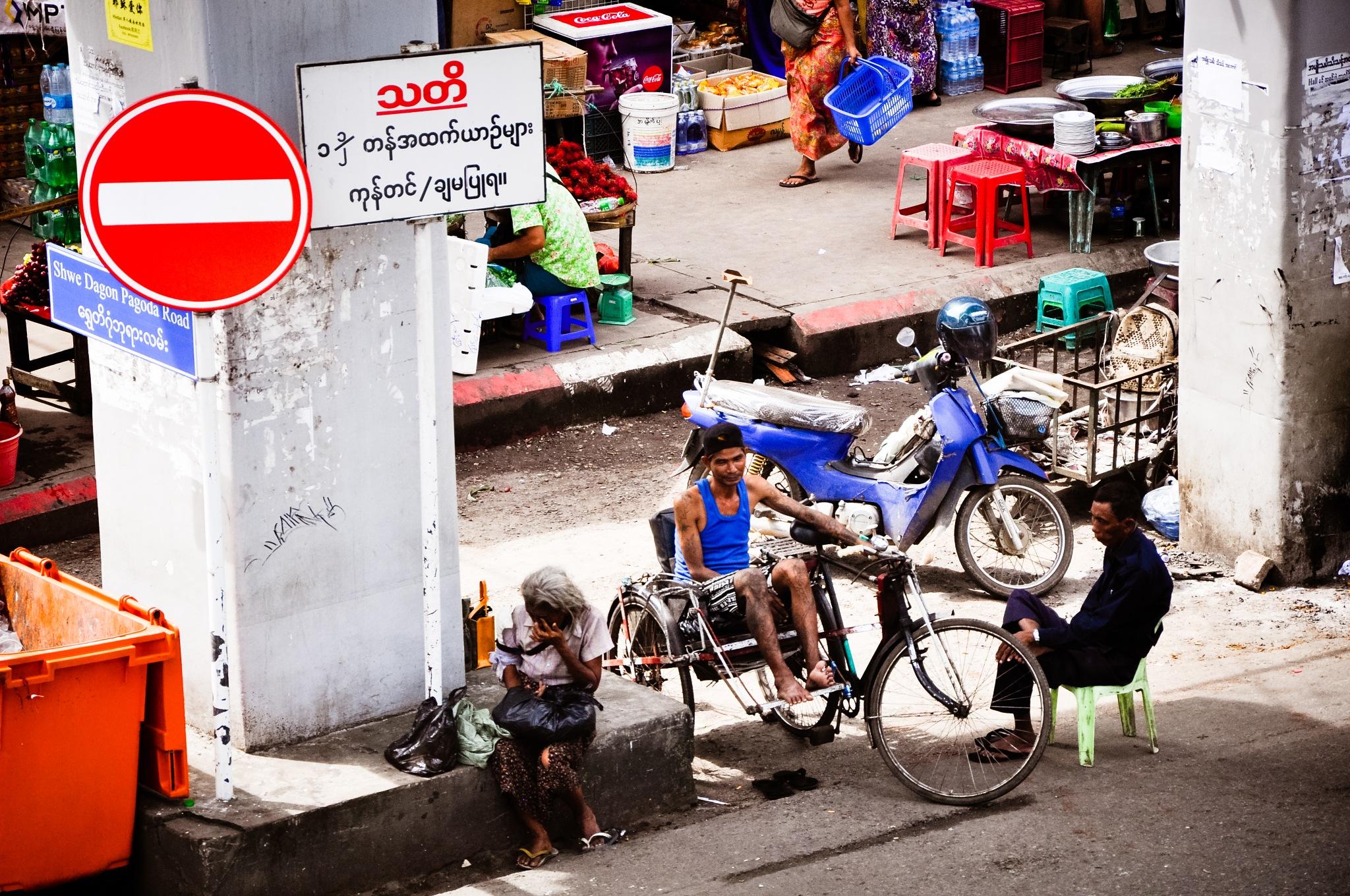 A Busy Street Corner (Myanmar) by Jiri Bielicky