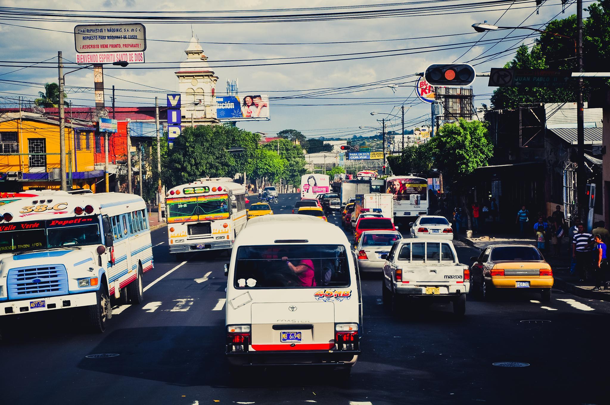 Busy Street in San Salvador (El Salvador) by Jiri Bielicky
