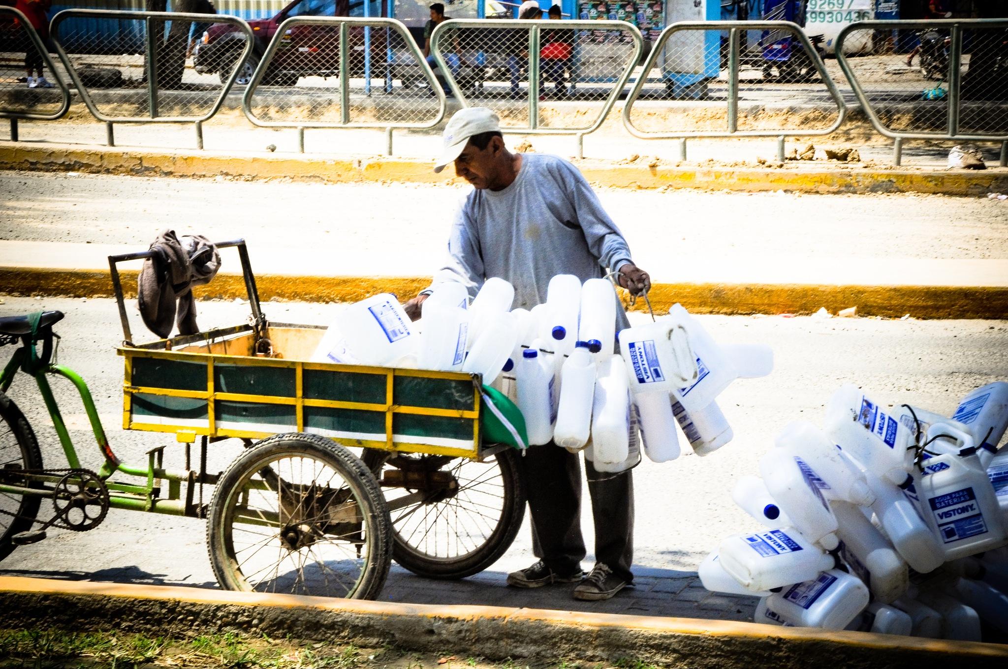 Selling Distilled Water (Peru) by Jiri Bielicky