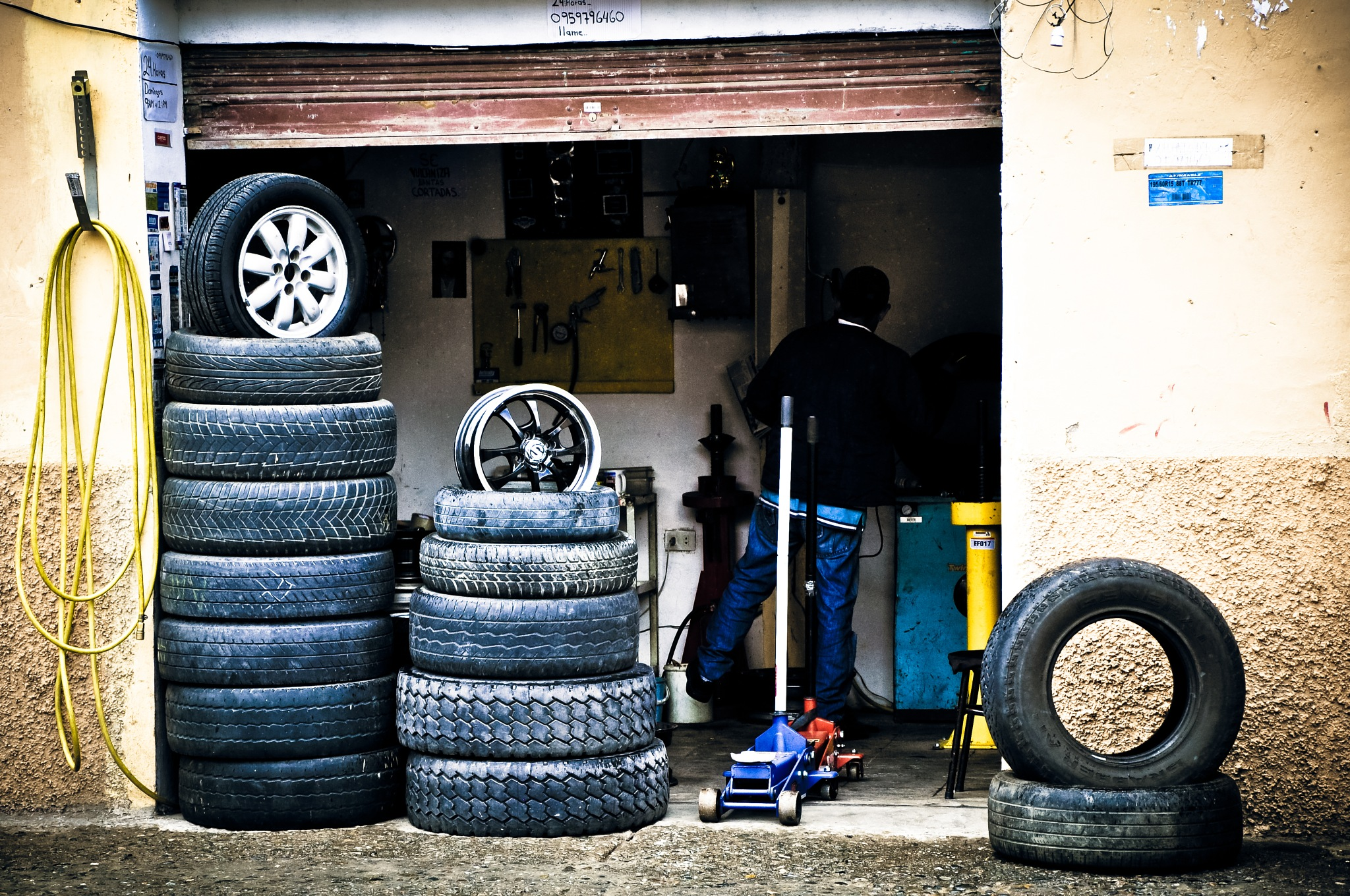 Tire Shop (Ecuador) by Jiri Bielicky