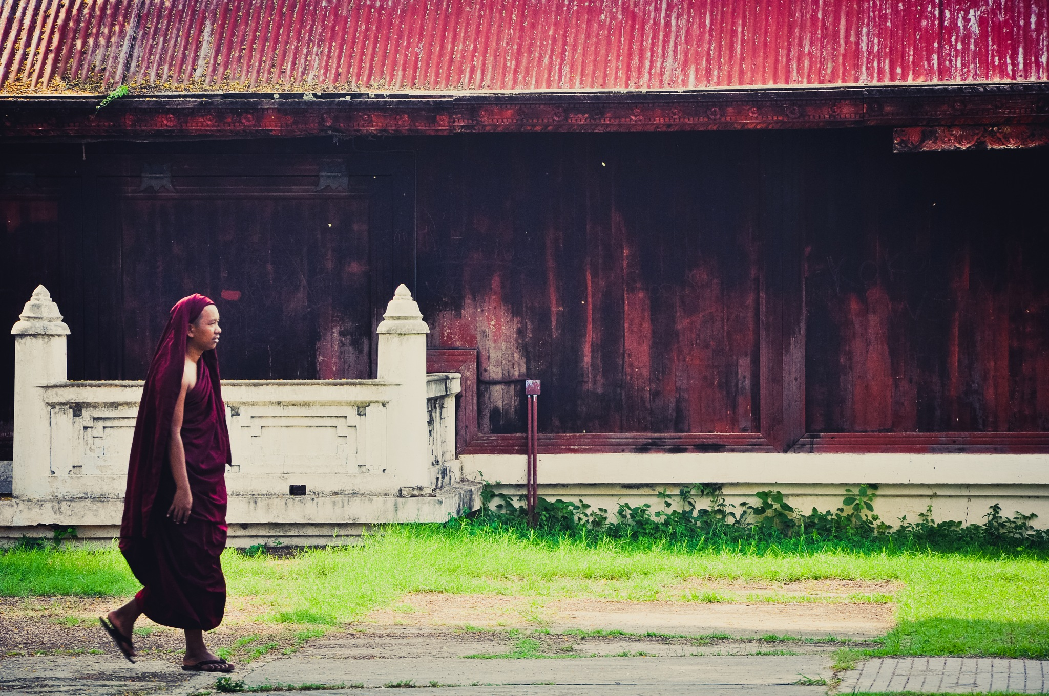 Monk On The Royal Palace Grounds (Myanmar) by Jiri Bielicky