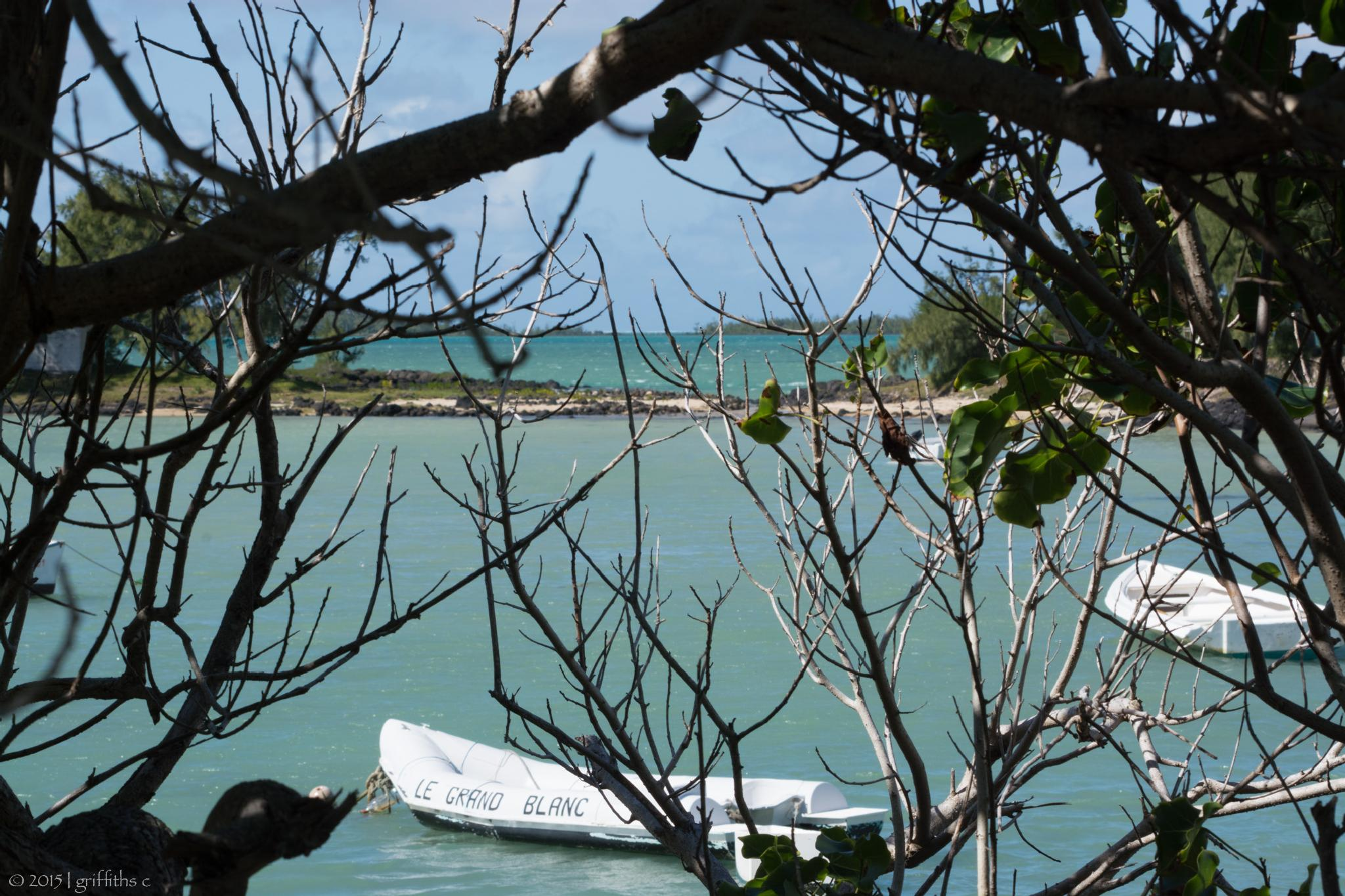 Photo in Sea and Sand #island #sea #beach #water #boat #sand #sunny #landscape