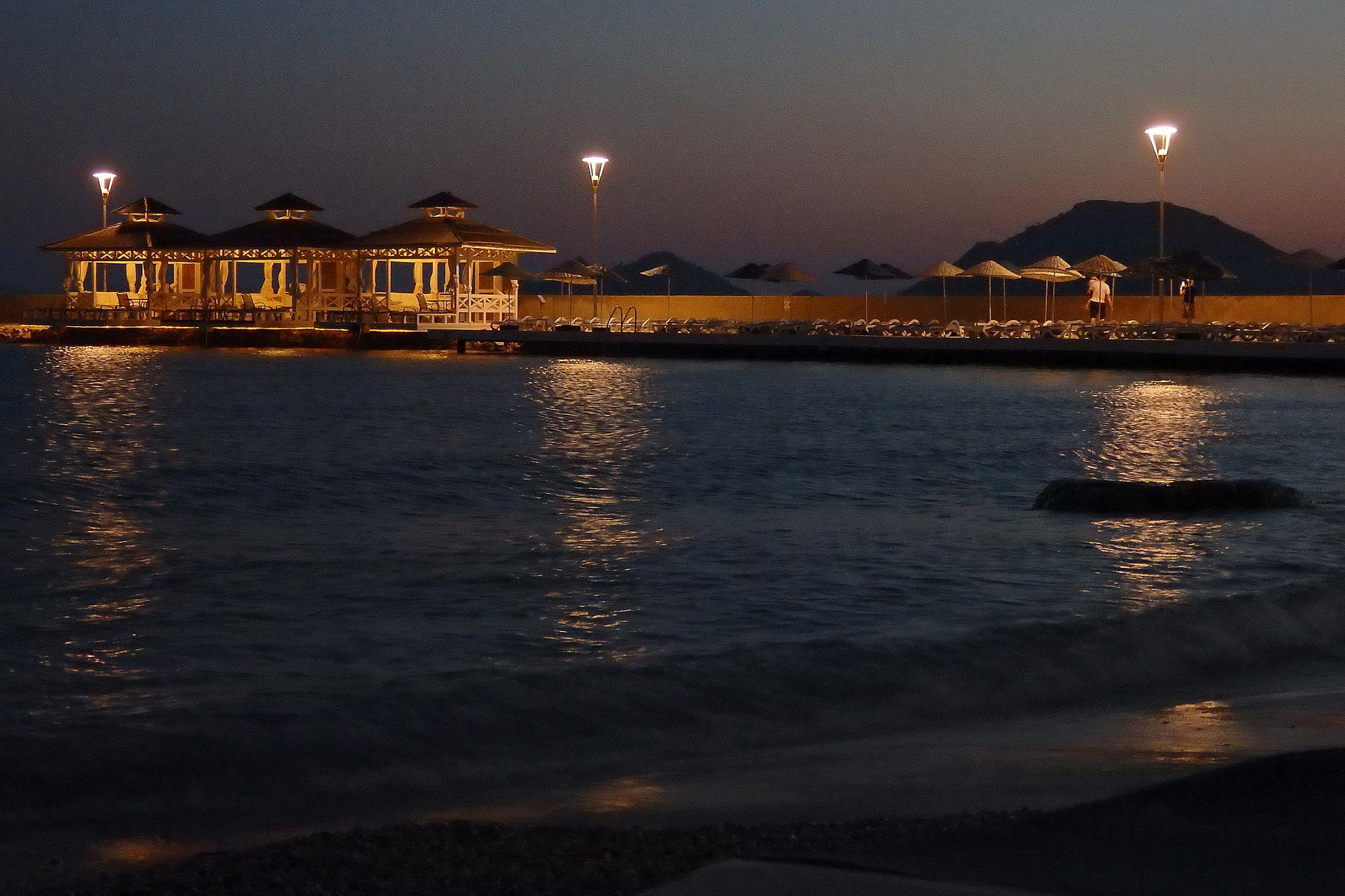 Photo in Architecture #seaside #beach #night #light #electrcity #sea #sand #sky
