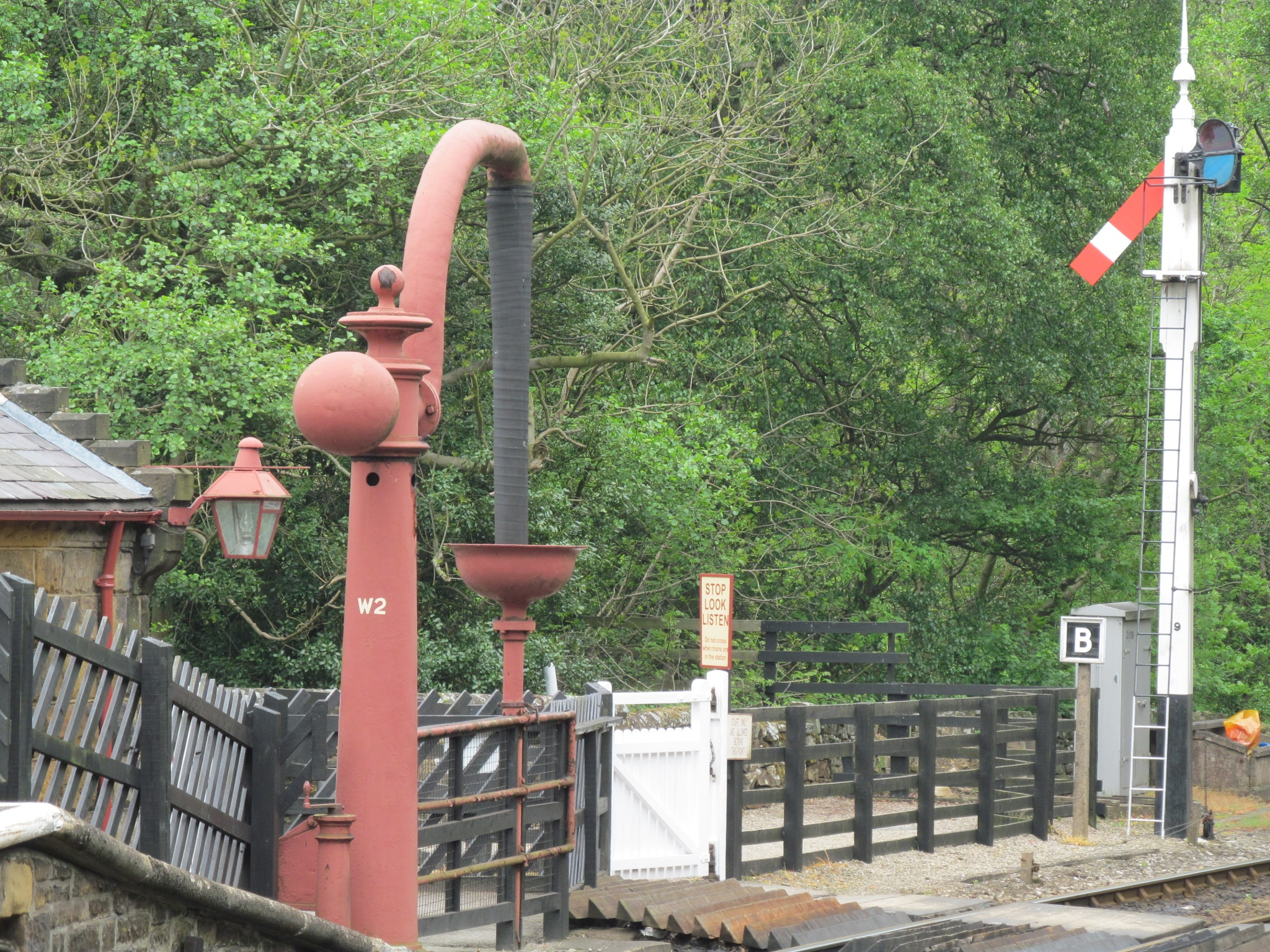 Station water pump & signal by joan croll