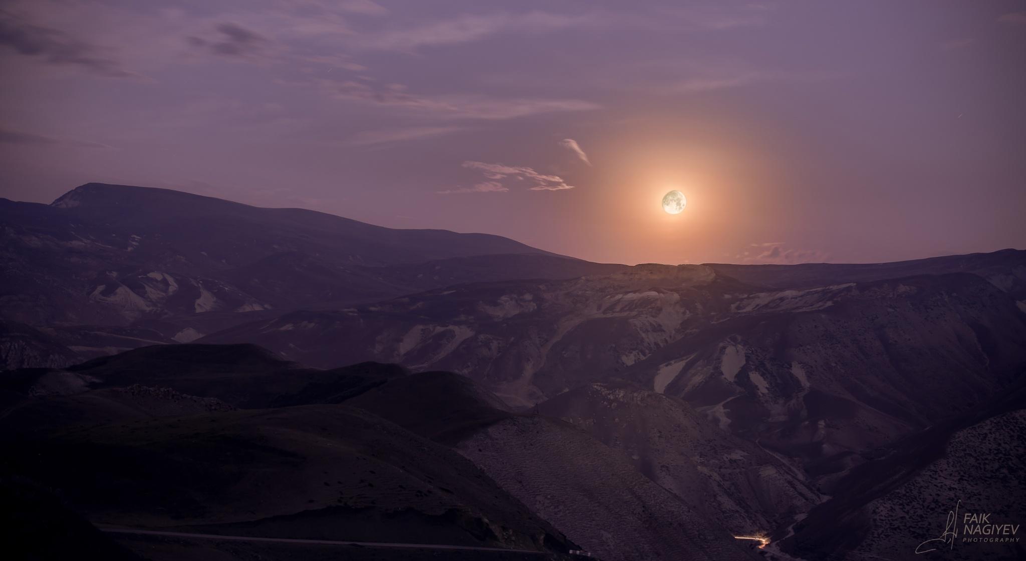 Moon in violet sky by Faik Nagiyev