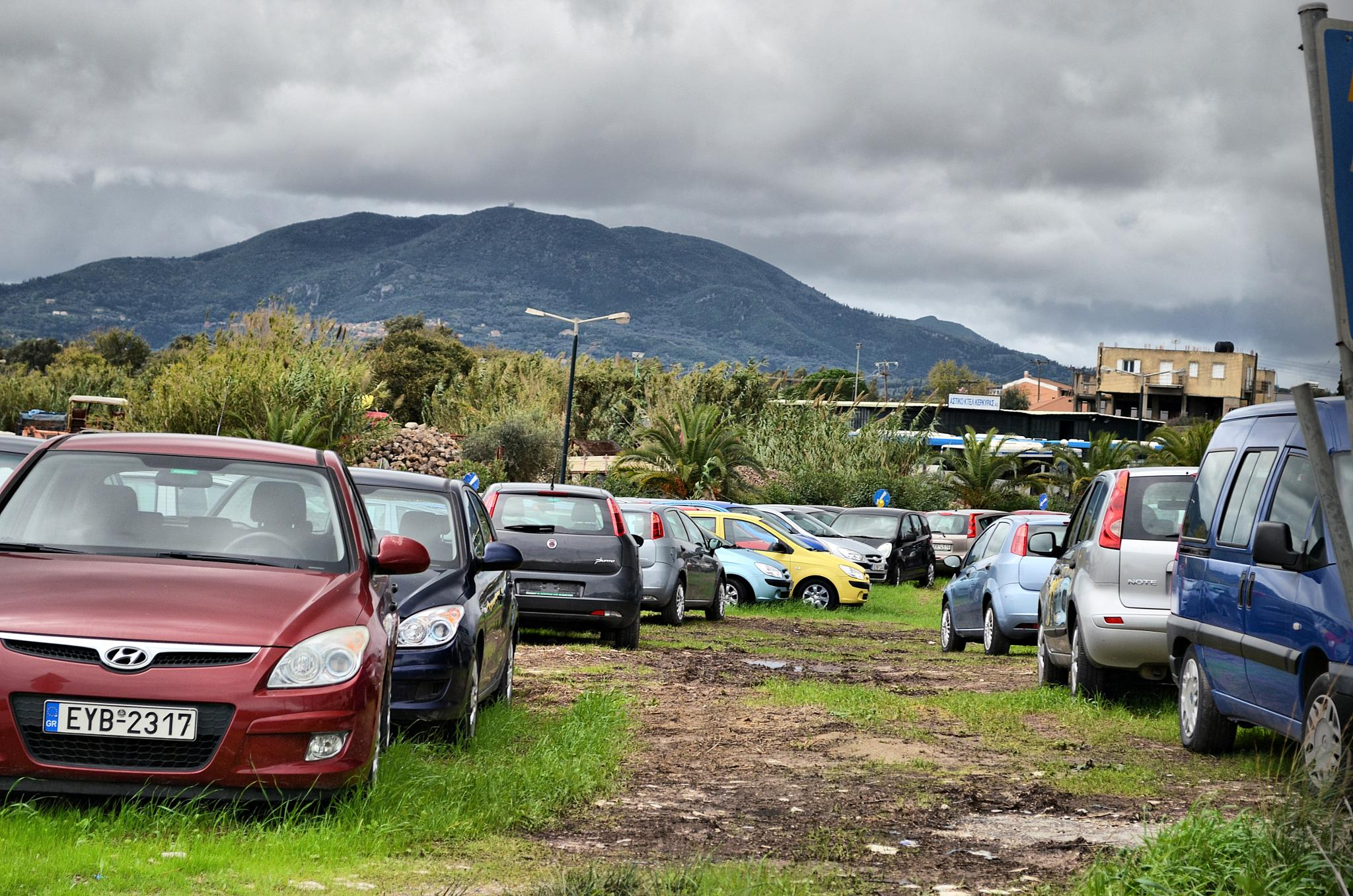 Cars and clouds by  Sotiris Hartzavalos