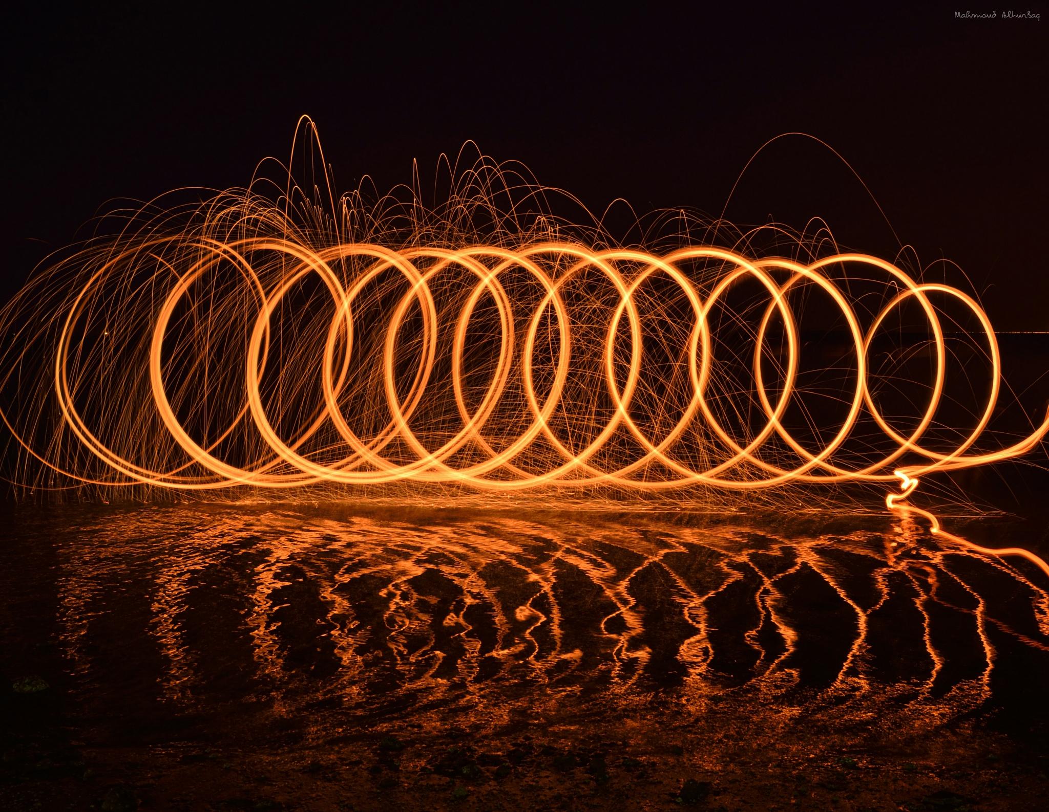 Steelwool on the beach by Mahmoud Alturbaq