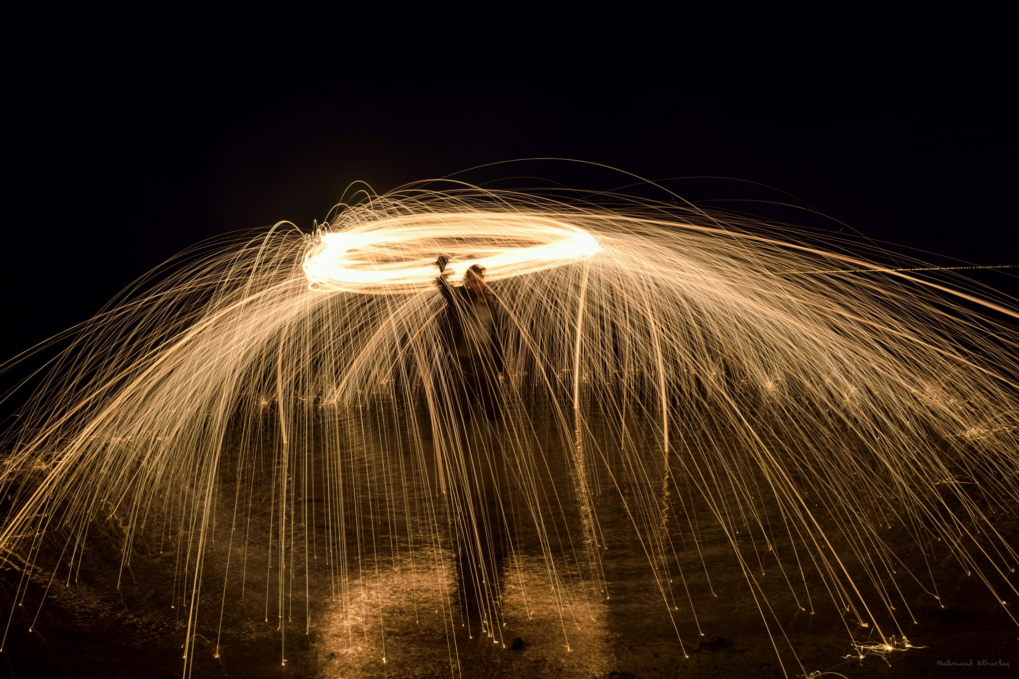 Steelwool on th beach by Mahmoud Alturbaq