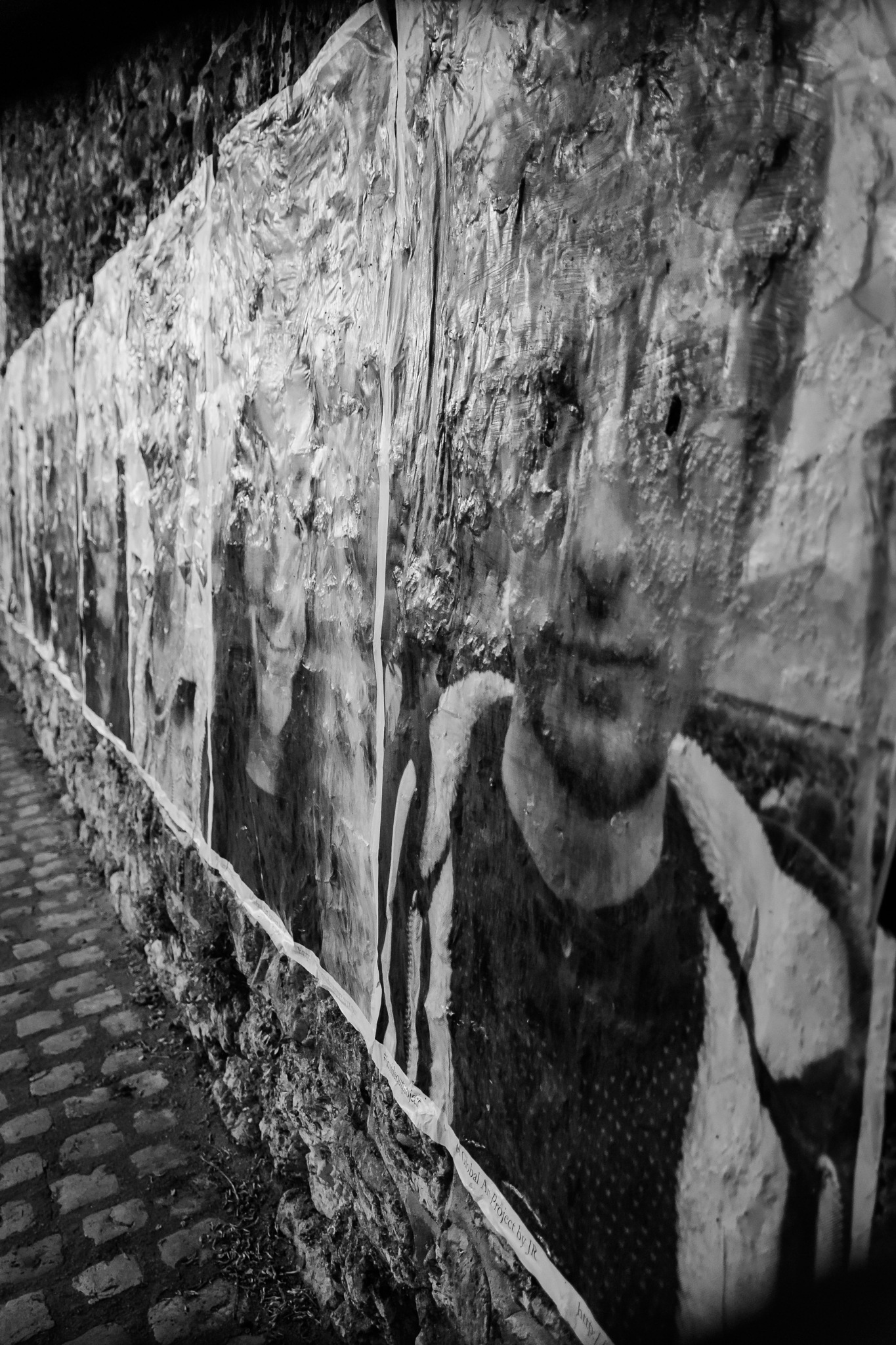 Faces on the wall 2 by Hervé Samson