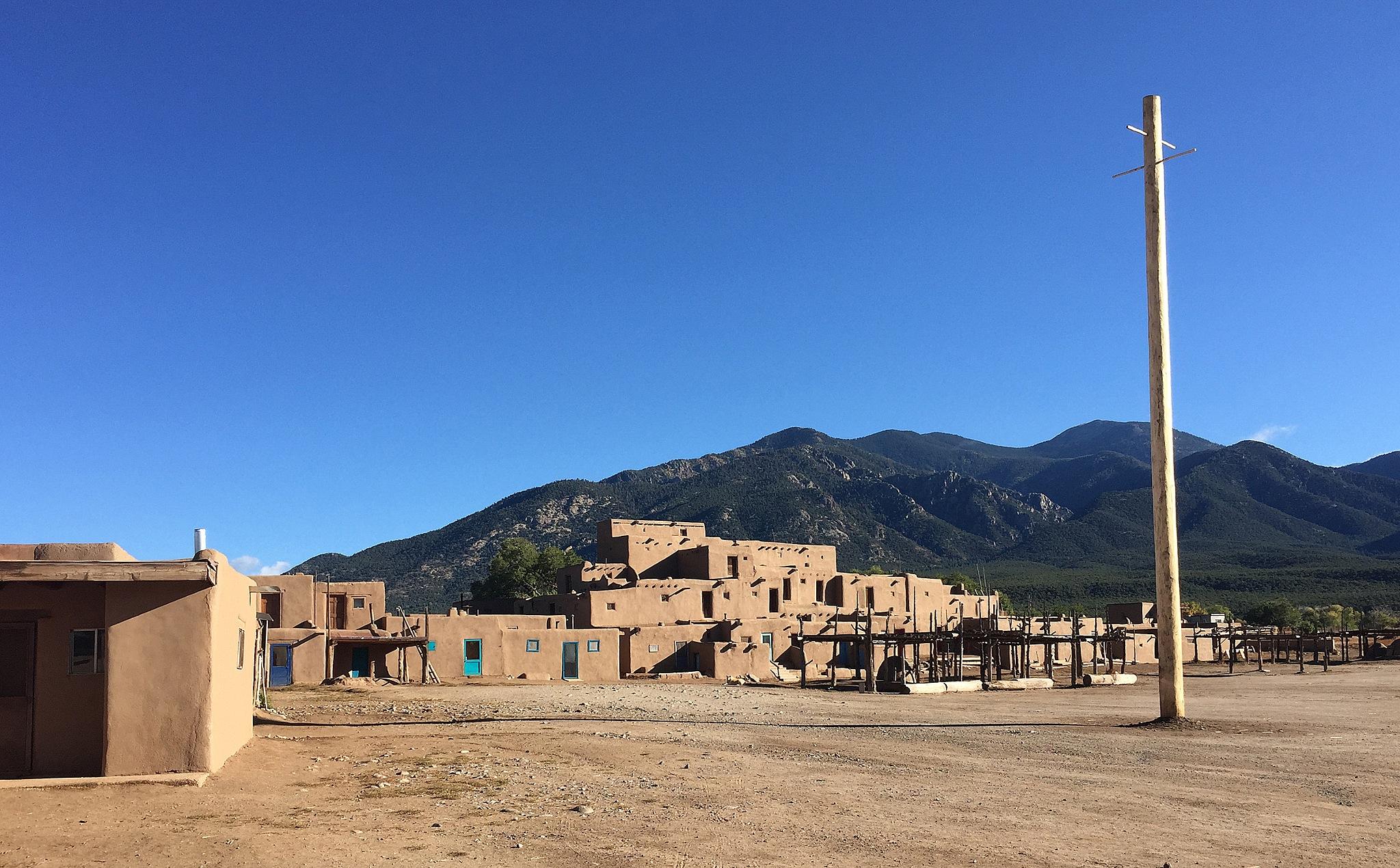 Taos Pueblo - North House by Carl Main