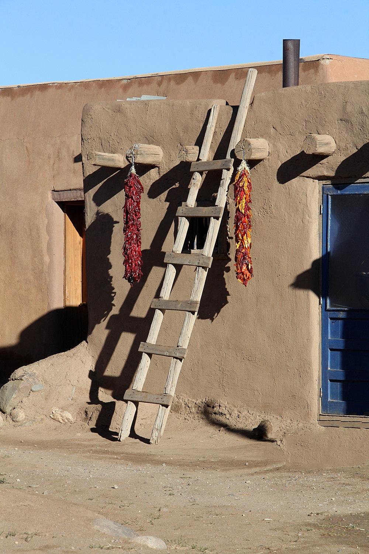 Taos Pueblo - Ristras by Carl Main