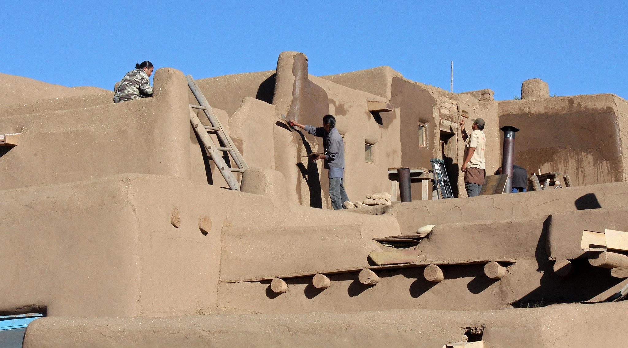 Taos Pueblo - Refreshing Adobe by Carl Main