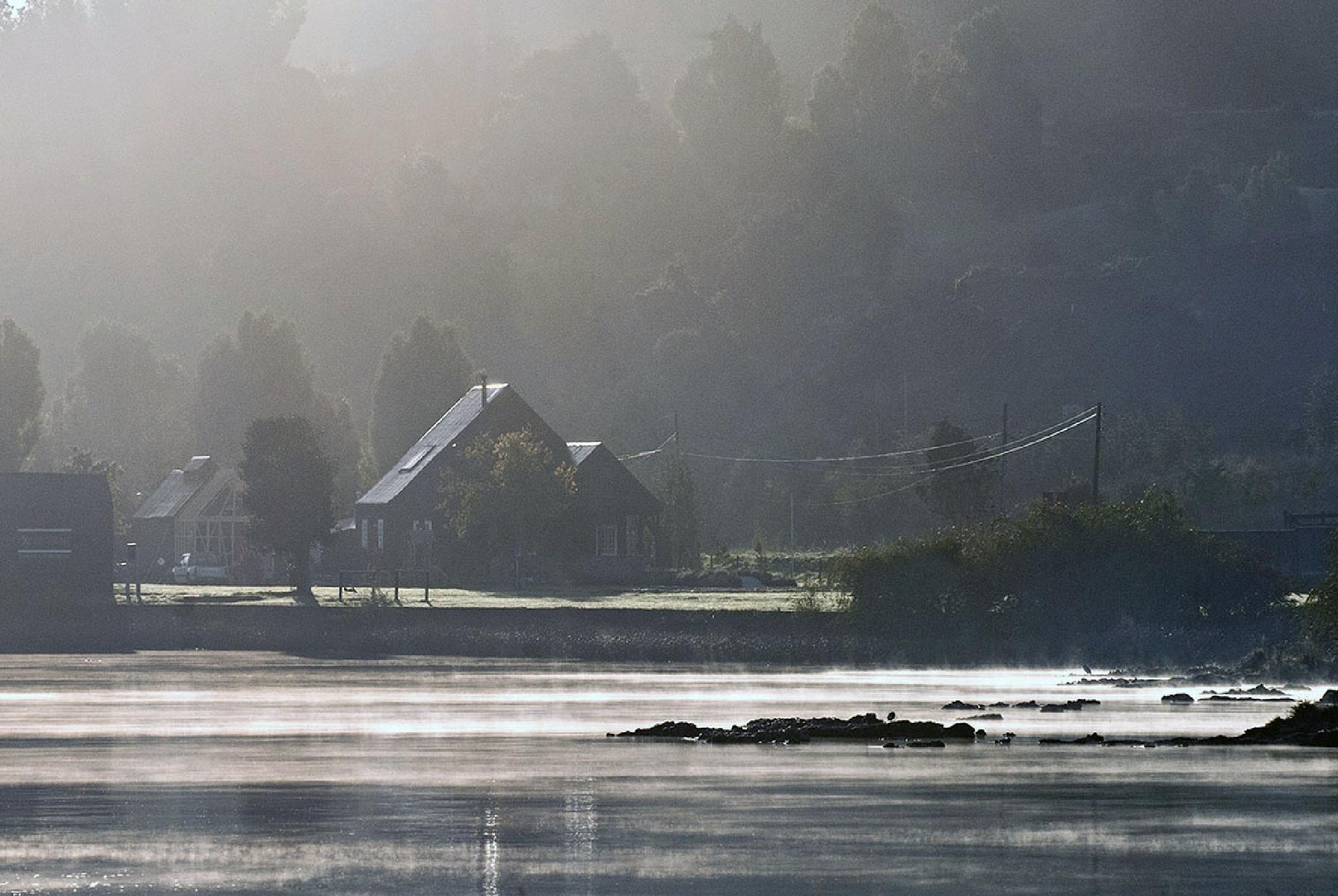 boat house in the fog by ivankonar