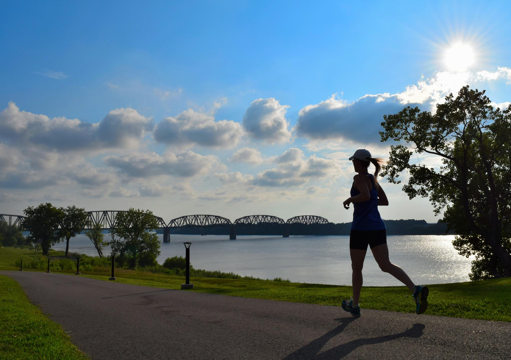 Runner on the River walk by LornaWLittrell