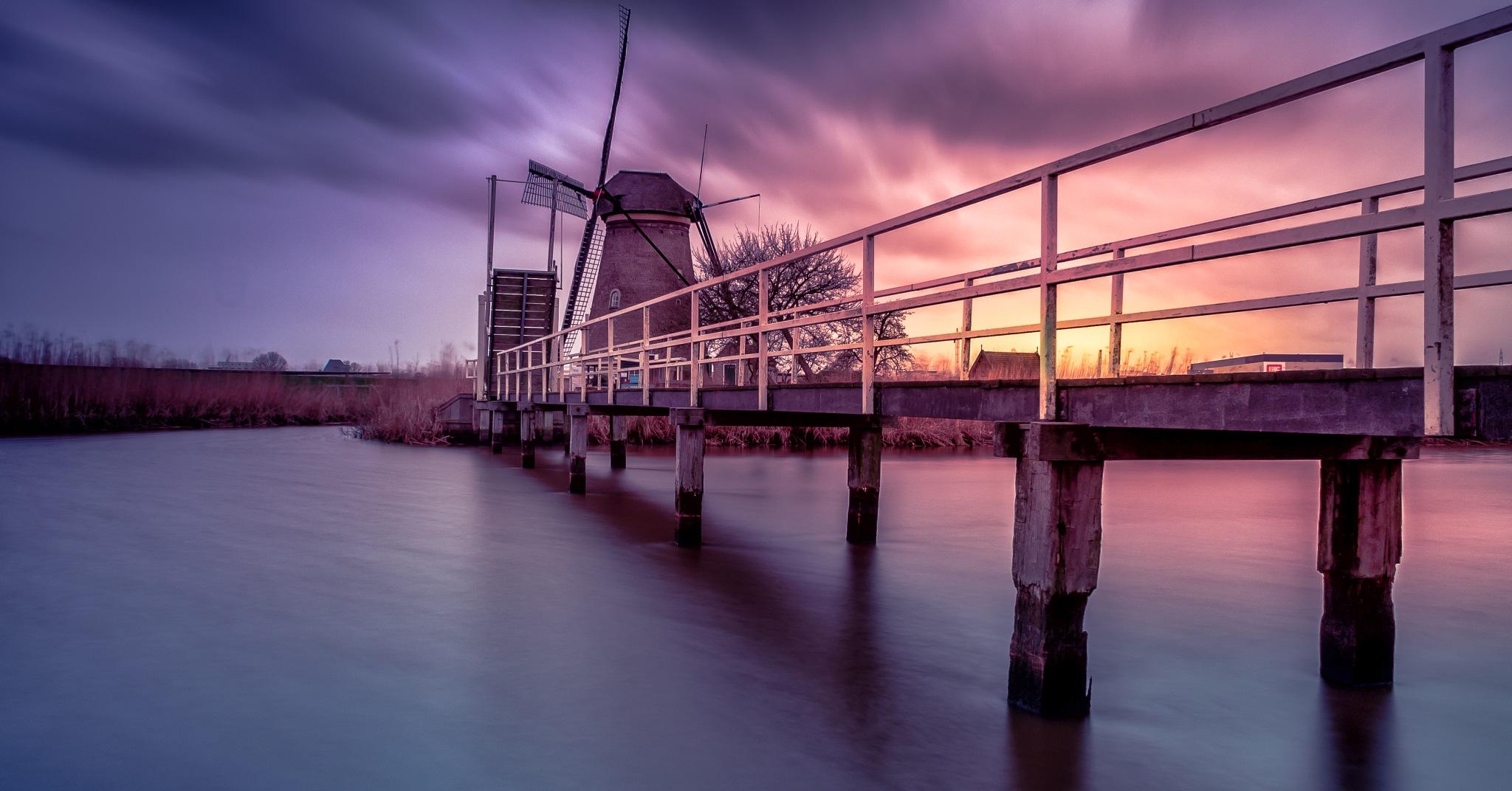 Dutch windmill in the storm by Stef van Winssen