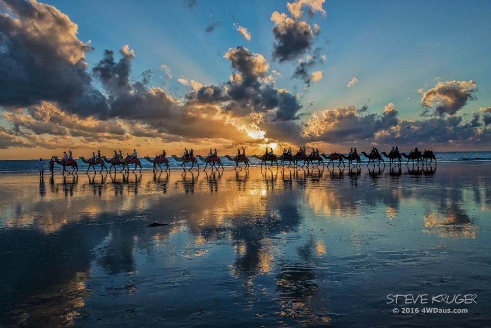 Camel Safari at sunset on Cable Beach WA, Australia by Steve Kruger