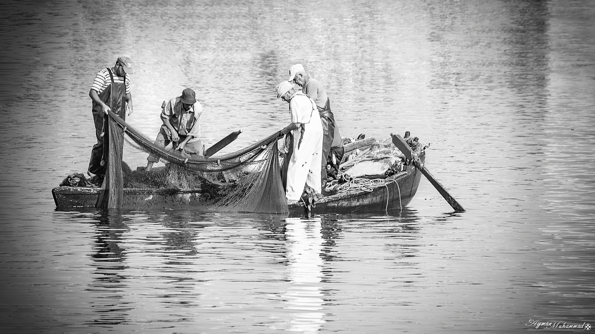 Small fishing boat with hard work by AymanMuhammad
