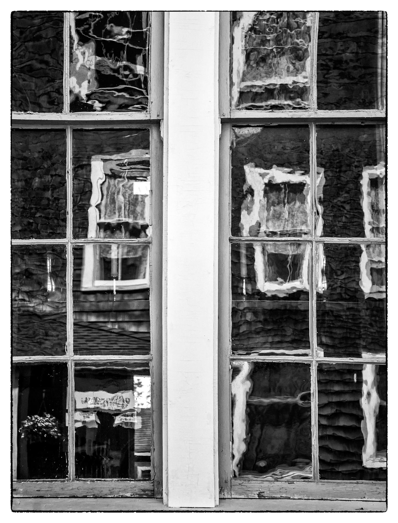 Church window reflecting Monhegan House, Monhegan Island, Maine. June 2016. by Carol-Lynn Rössel