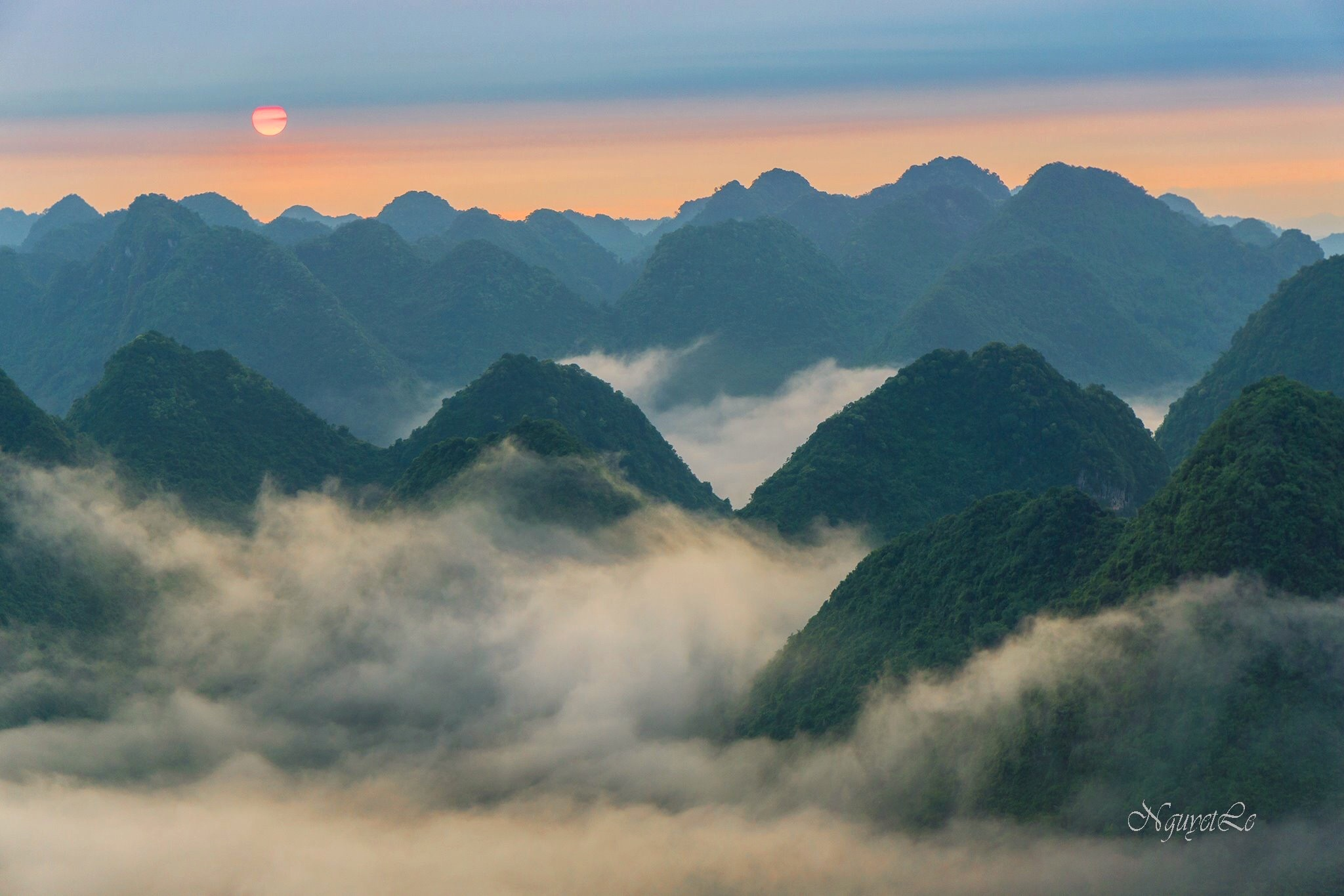 Sunrise beyond mountain and clouds  by Nguyet Le