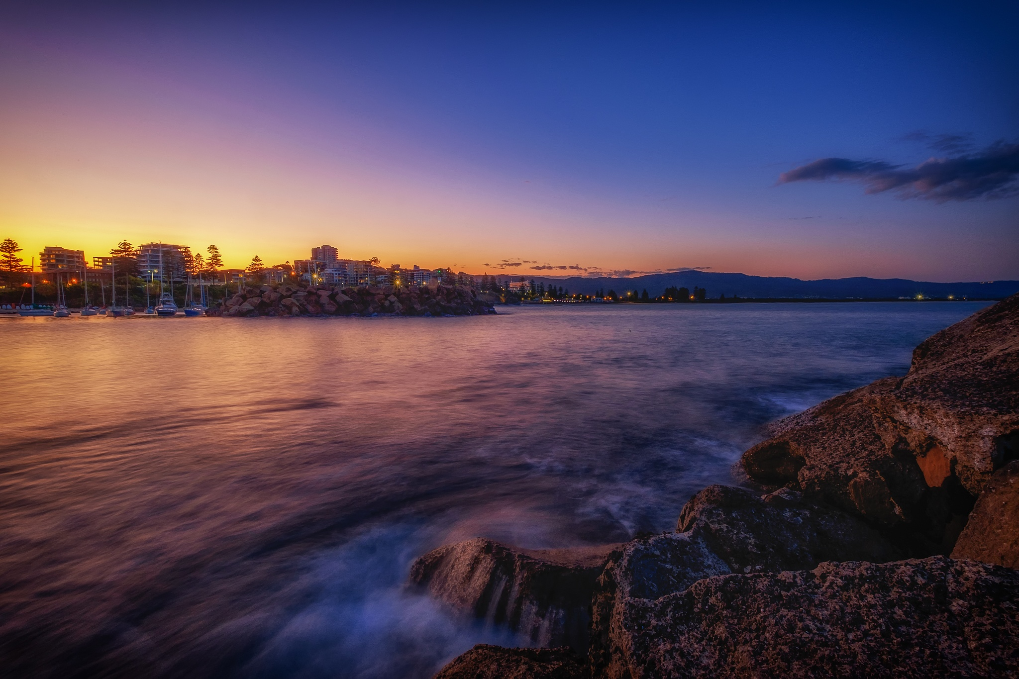A Golden Sunset at the Breakwater by Peter Medbury