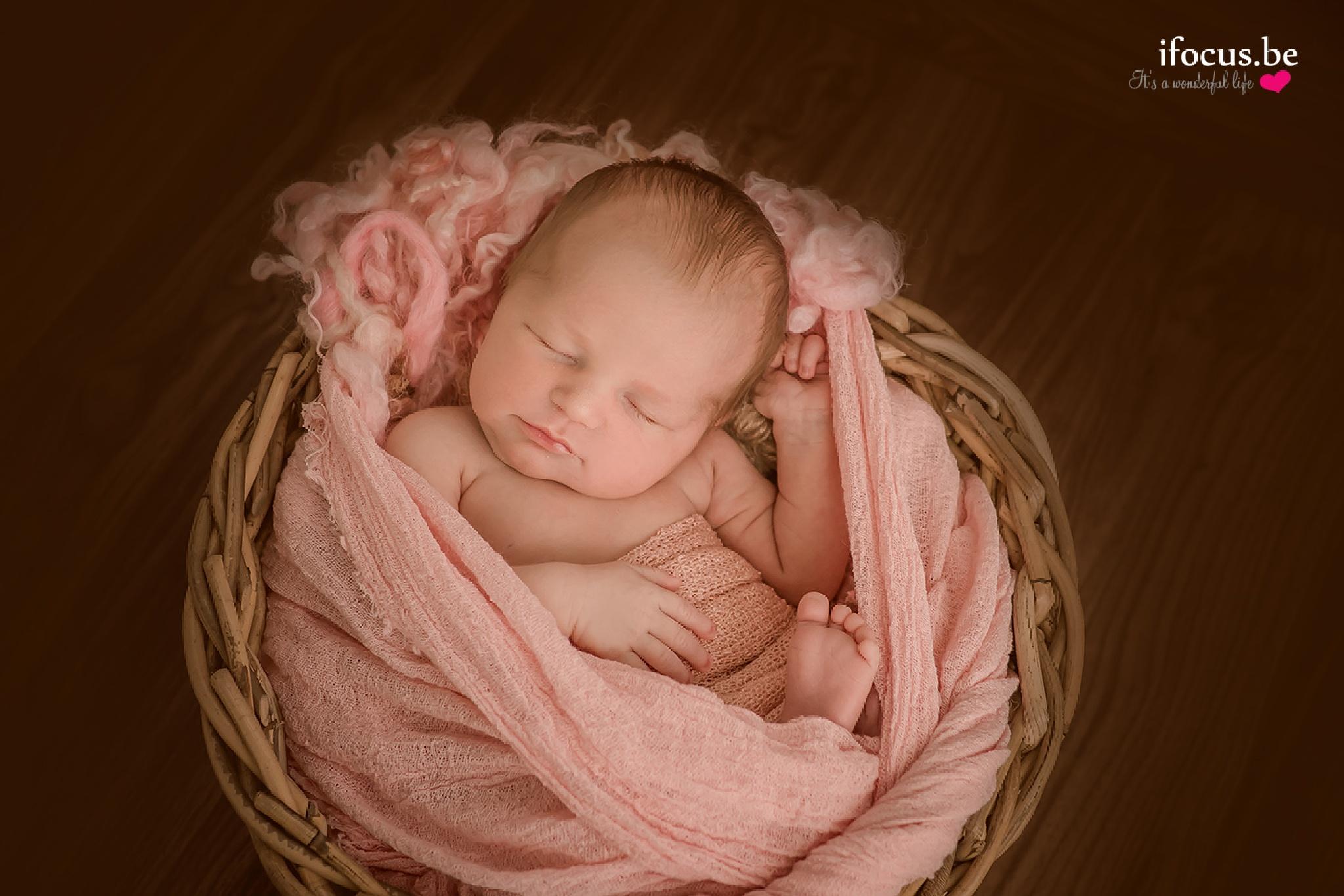 Newborn girl in pink by ifocus